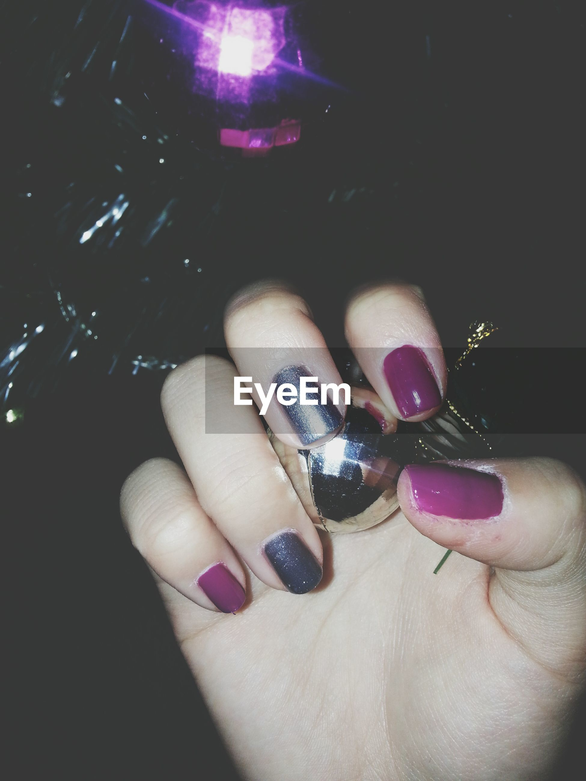 person, part of, human finger, holding, lifestyles, cropped, indoors, personal perspective, leisure activity, unrecognizable person, nail polish, close-up, fashion, studio shot, high angle view, showing