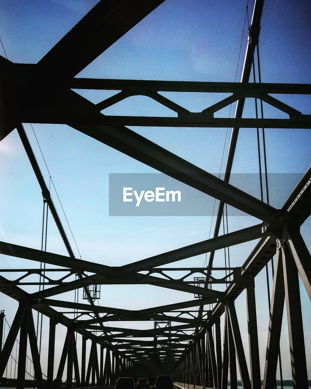sky, built structure, architecture, metal, low angle view, nature, clear sky, no people, bridge, connection, day, blue, bridge - man made structure, outdoors, transportation, pattern, steel, alloy, sunlight, girder