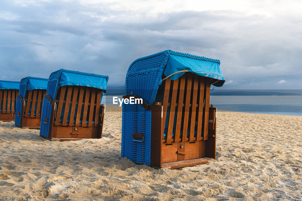 HOODED CHAIRS ON BEACH