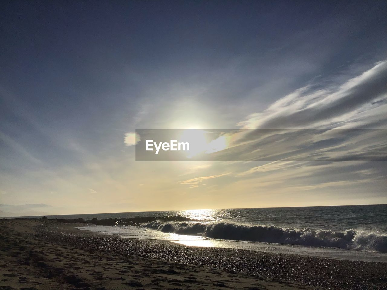 sea, water, sky, scenics - nature, beach, beauty in nature, land, horizon, horizon over water, cloud - sky, motion, wave, tranquil scene, tranquility, nature, sunset, no people, idyllic, sunlight, outdoors