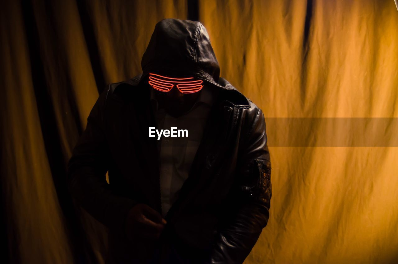 Man Wearing Illuminated Eyeglass While Zipping Jacket
