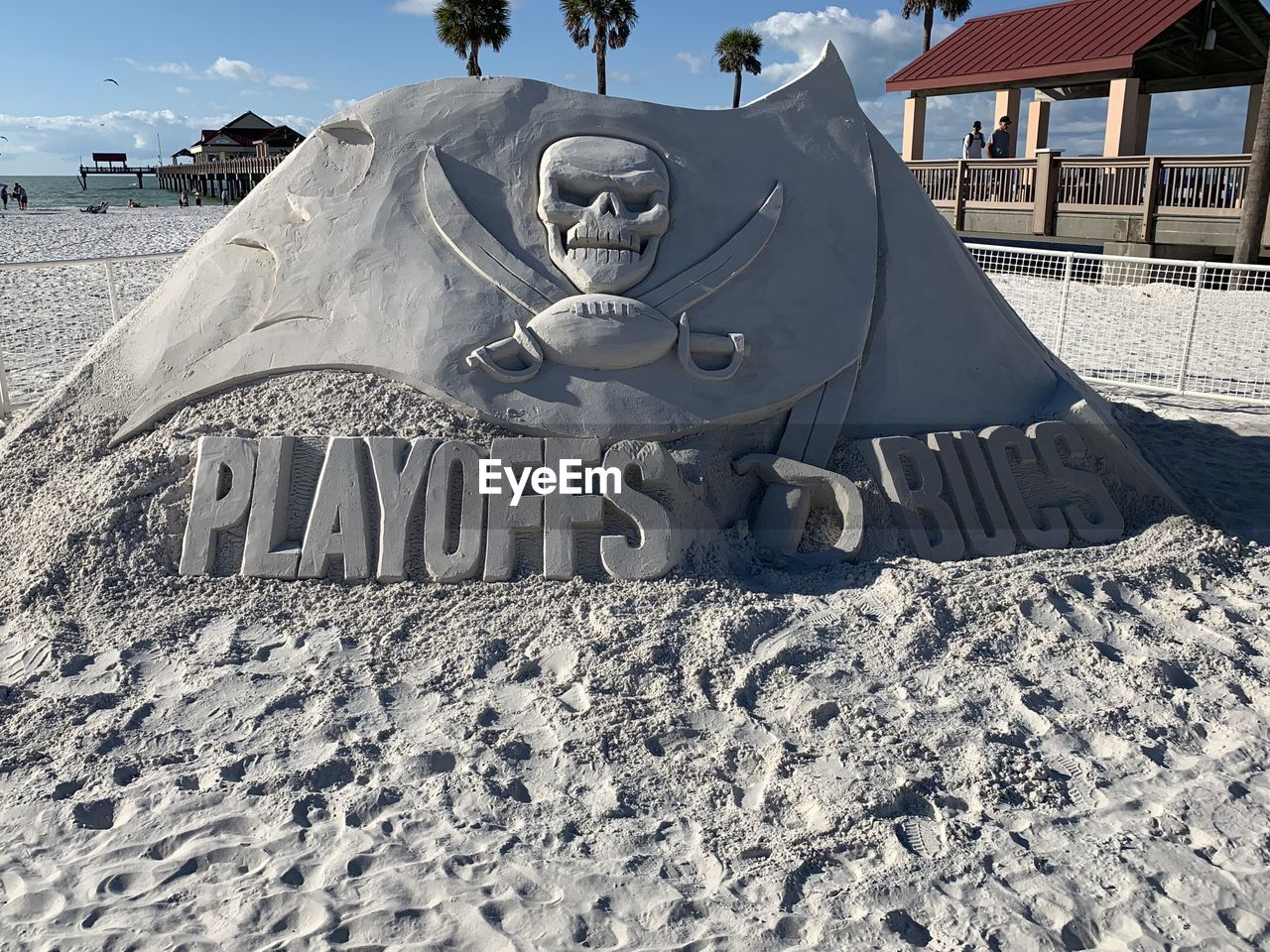SCULPTURE OF SAND AND TEXT ON LAND