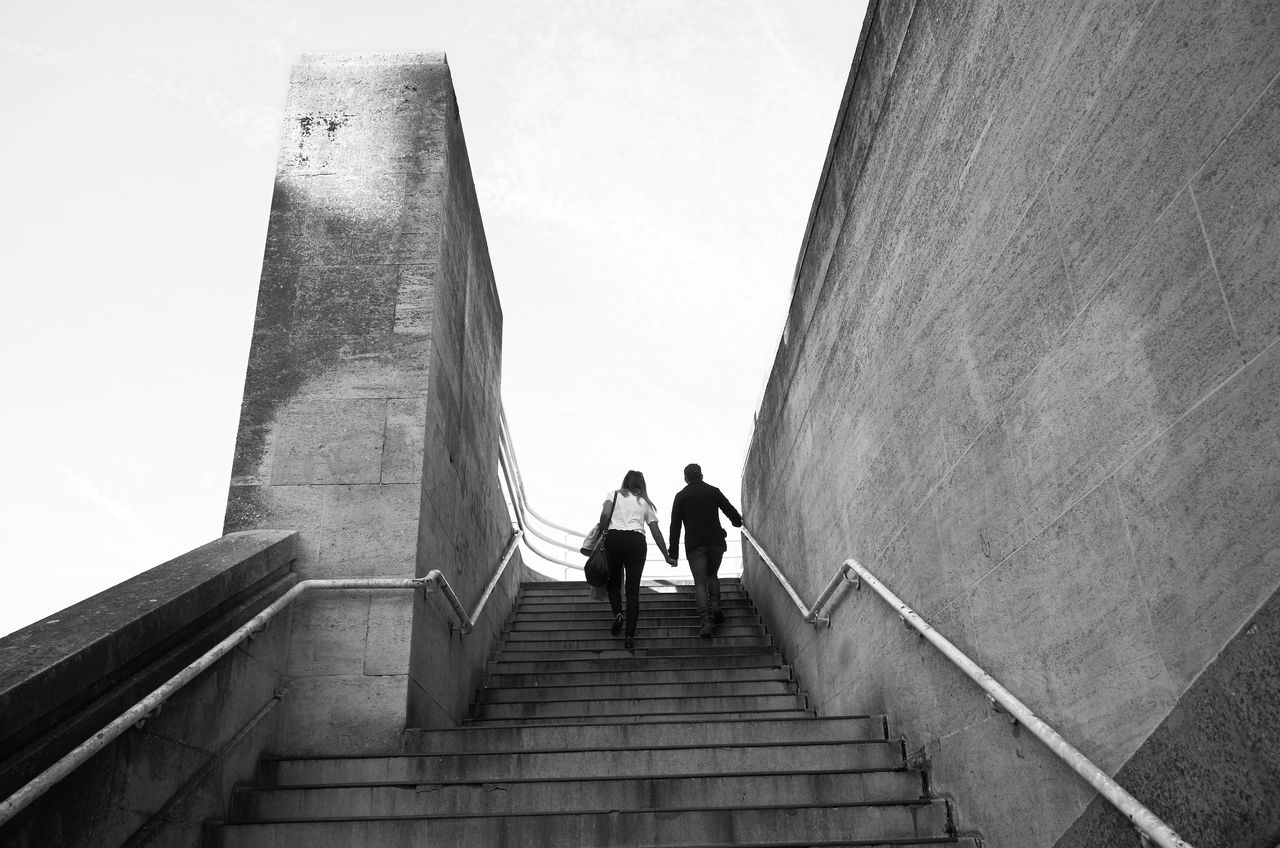 Low Angle View Of Man And Woman On Staircase