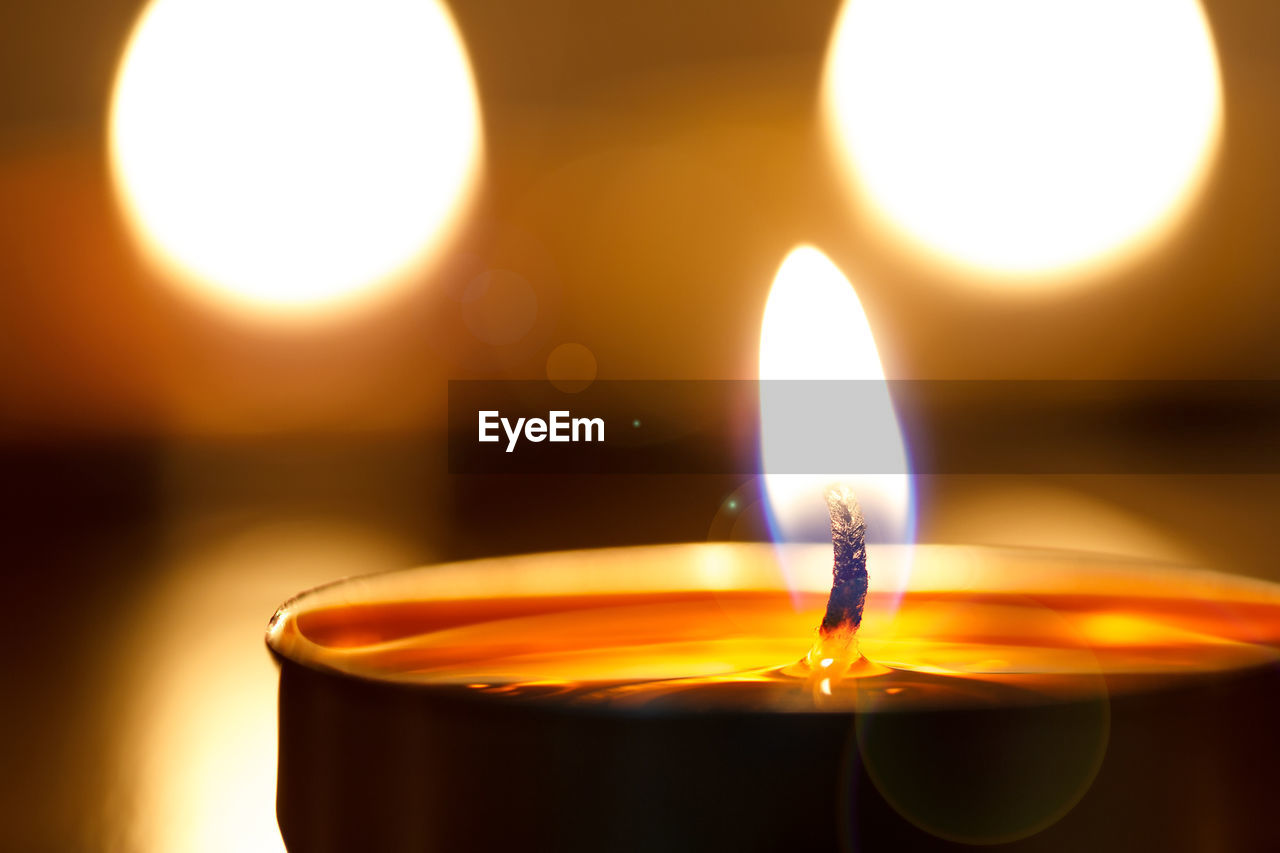 illuminated, burning, heat - temperature, fire, flame, glowing, candle, close-up, fire - natural phenomenon, indoors, nature, focus on foreground, orange color, lighting equipment, no people, wax, lens flare, motion, light - natural phenomenon, oil lamp, electric lamp, tea light, luminosity, melting