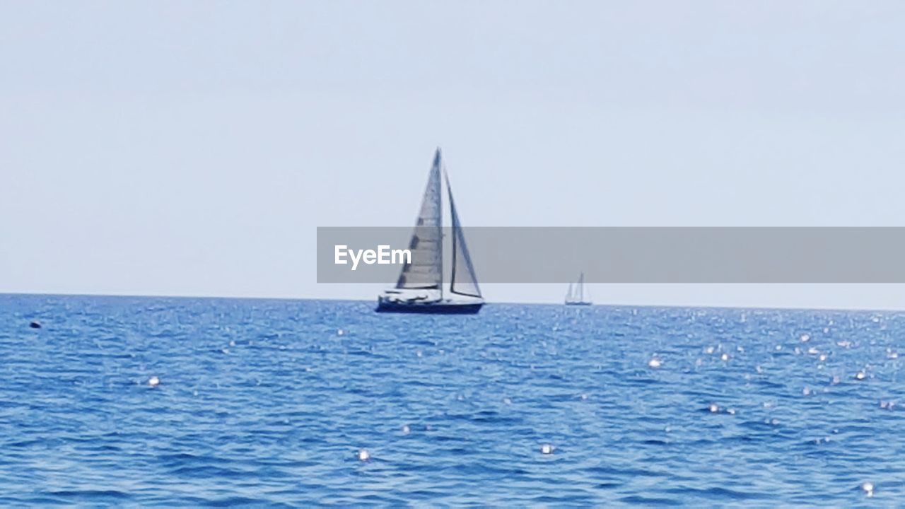 water, sea, nautical vessel, sailboat, sailing, mode of transportation, transportation, horizon over water, horizon, sky, clear sky, nature, ship, copy space, beauty in nature, blue, sailing ship, scenics - nature, yachting, no people, yacht, luxury