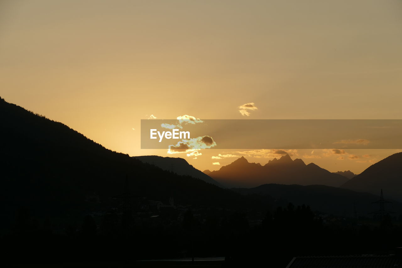 mountain, beauty in nature, sky, scenics - nature, sunset, mountain range, tranquil scene, silhouette, tranquility, environment, nature, no people, idyllic, cloud - sky, non-urban scene, landscape, orange color, outdoors, sunlight, copy space, mountain peak