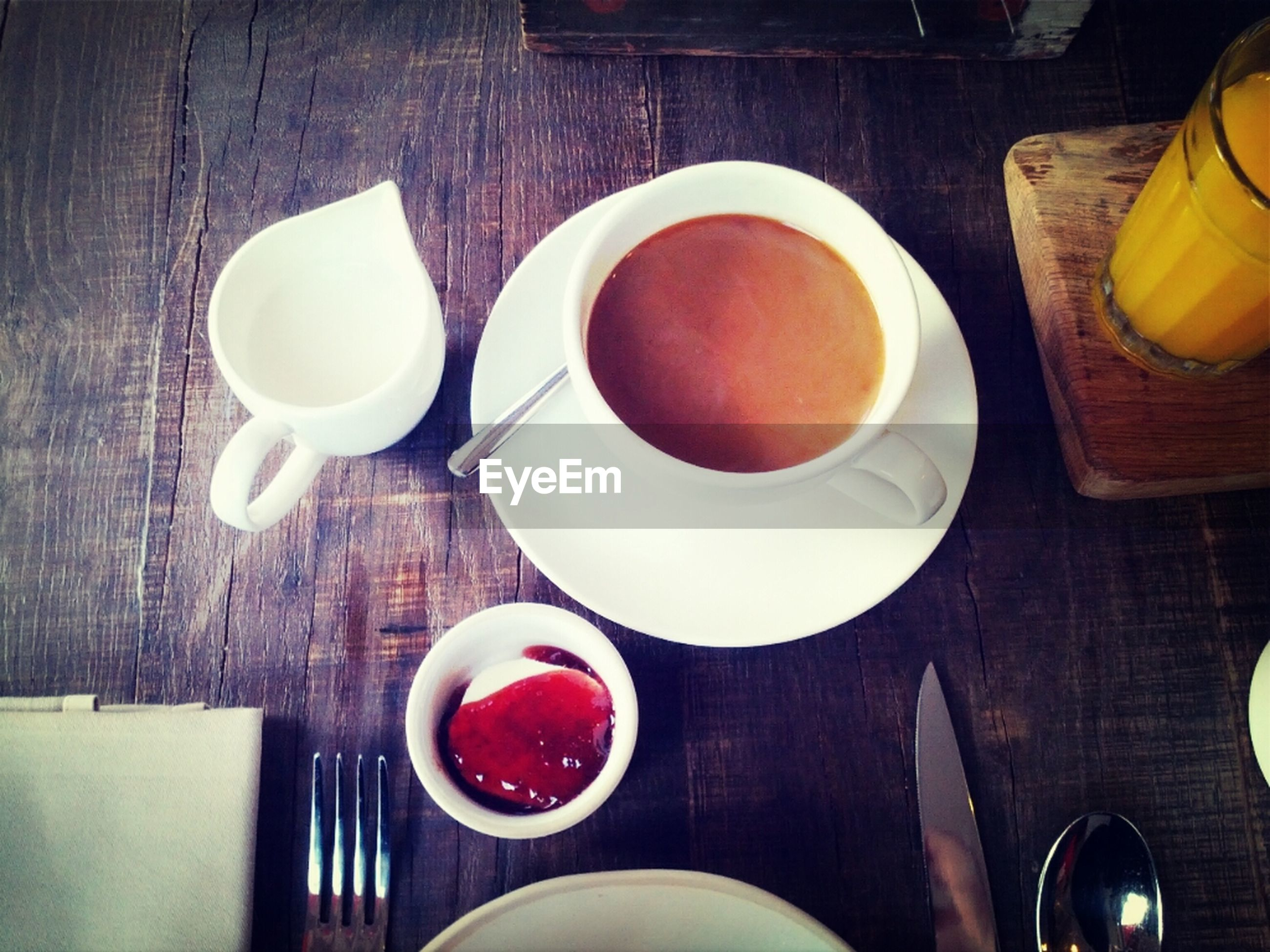Coffee with milk on wooden table