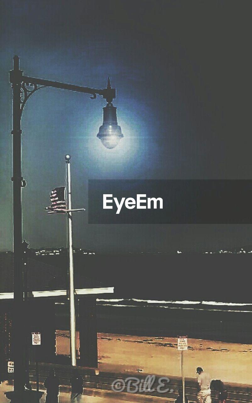 lighting equipment, street light, illuminated, night, outdoors, no people, sea, water, city, sky