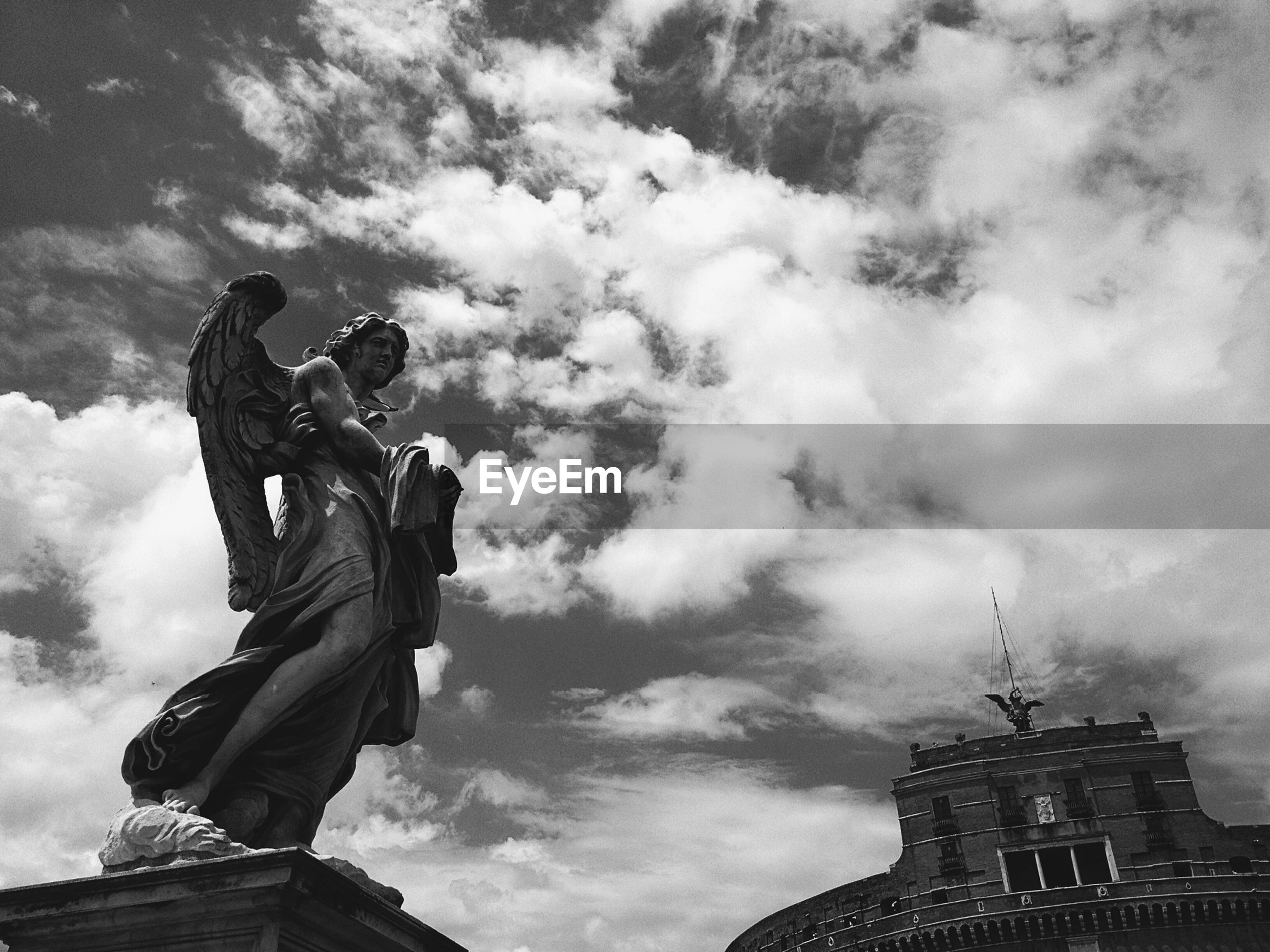 Angel statue against sky