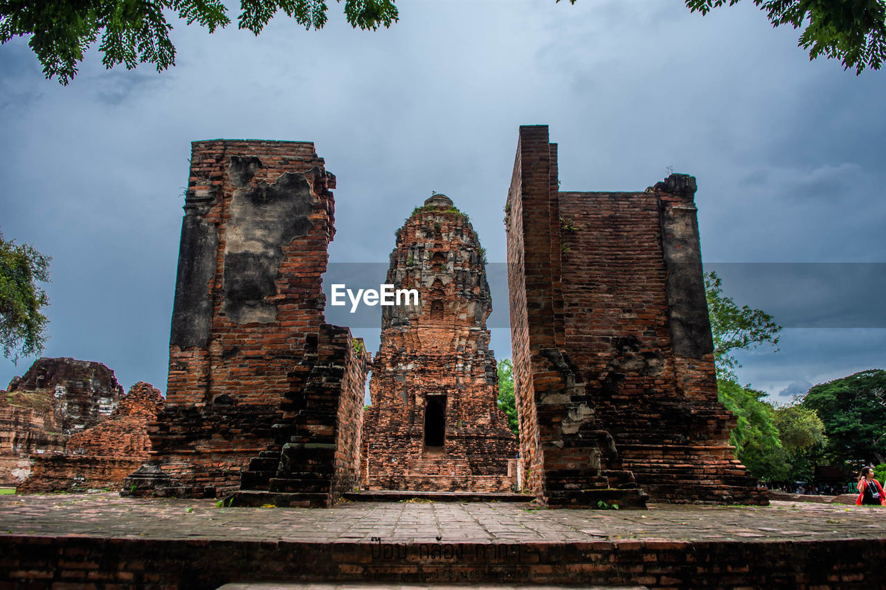 architecture, built structure, sky, history, the past, ancient, building exterior, old ruin, old, travel destinations, religion, place of worship, belief, cloud - sky, nature, low angle view, tourism, building, spirituality, no people, ancient civilization, ruined, outdoors, deterioration, archaeology