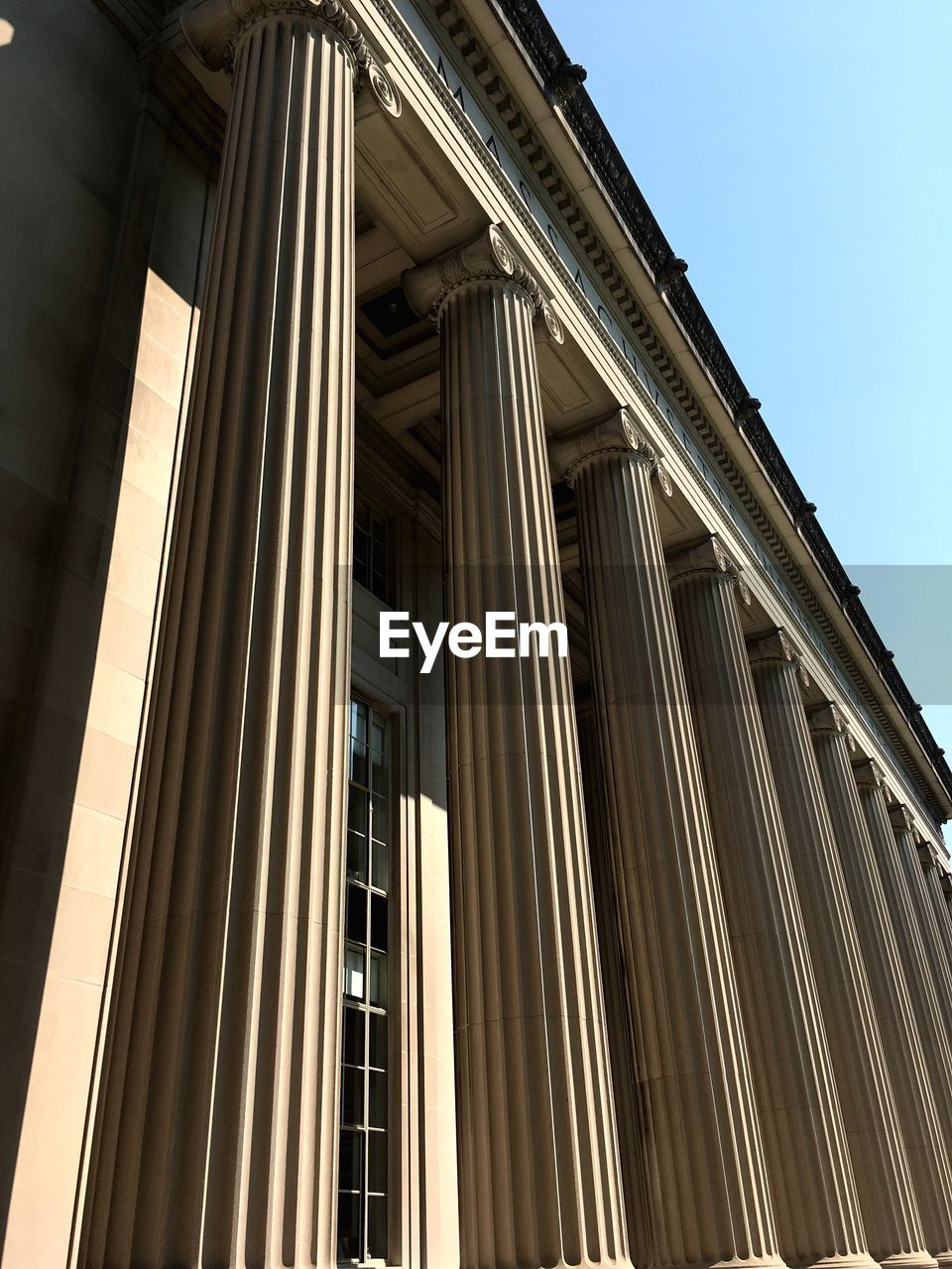 built structure, architecture, low angle view, building exterior, architectural column, building, sky, no people, city, nature, day, sunlight, outdoors, window, courthouse, clear sky, government, office building exterior, history, neo-classical