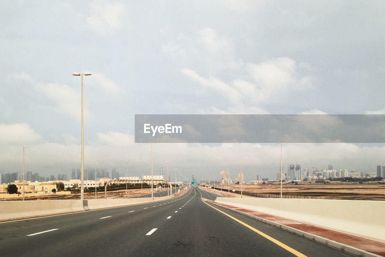 Road in city against sky