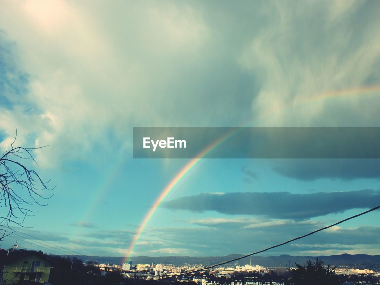 rainbow, double rainbow, cloud - sky, sky, beauty in nature, nature, scenics, no people, outdoors, day, building exterior, architecture