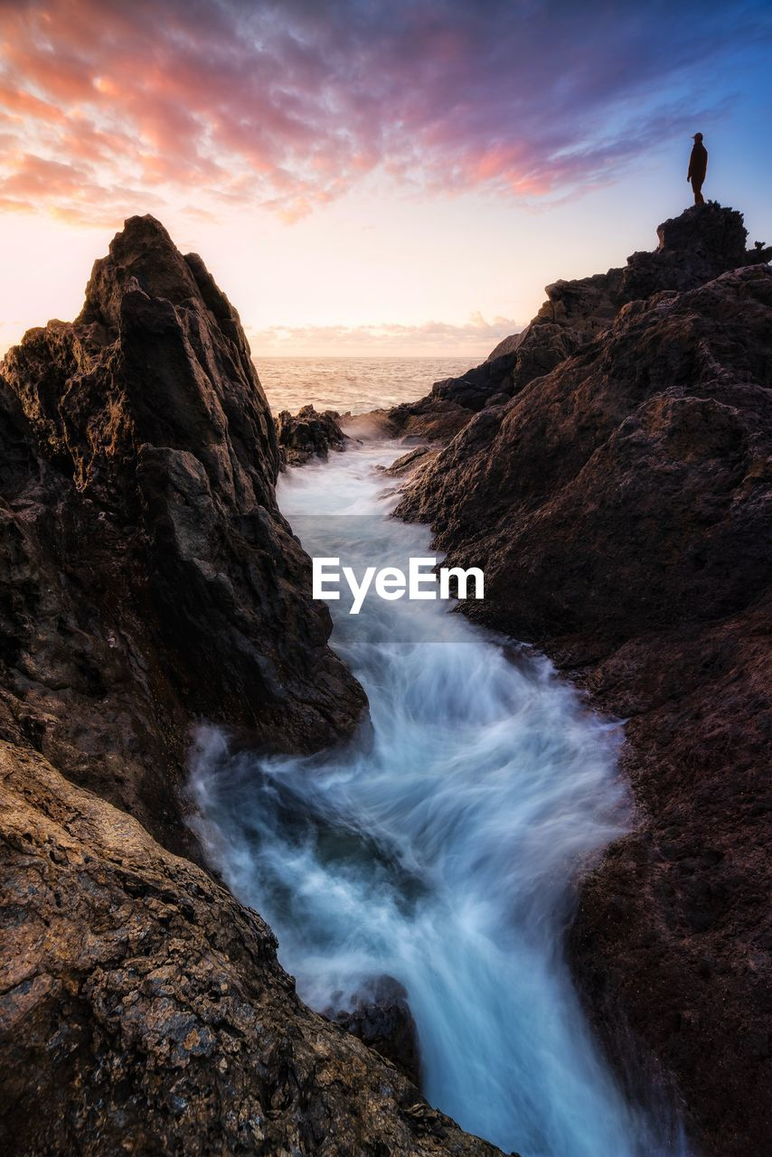 rock, rock - object, beauty in nature, solid, scenics - nature, sky, rock formation, sunset, tranquil scene, tranquility, water, motion, non-urban scene, nature, idyllic, land, sea, long exposure, mountain, outdoors, formation, power in nature