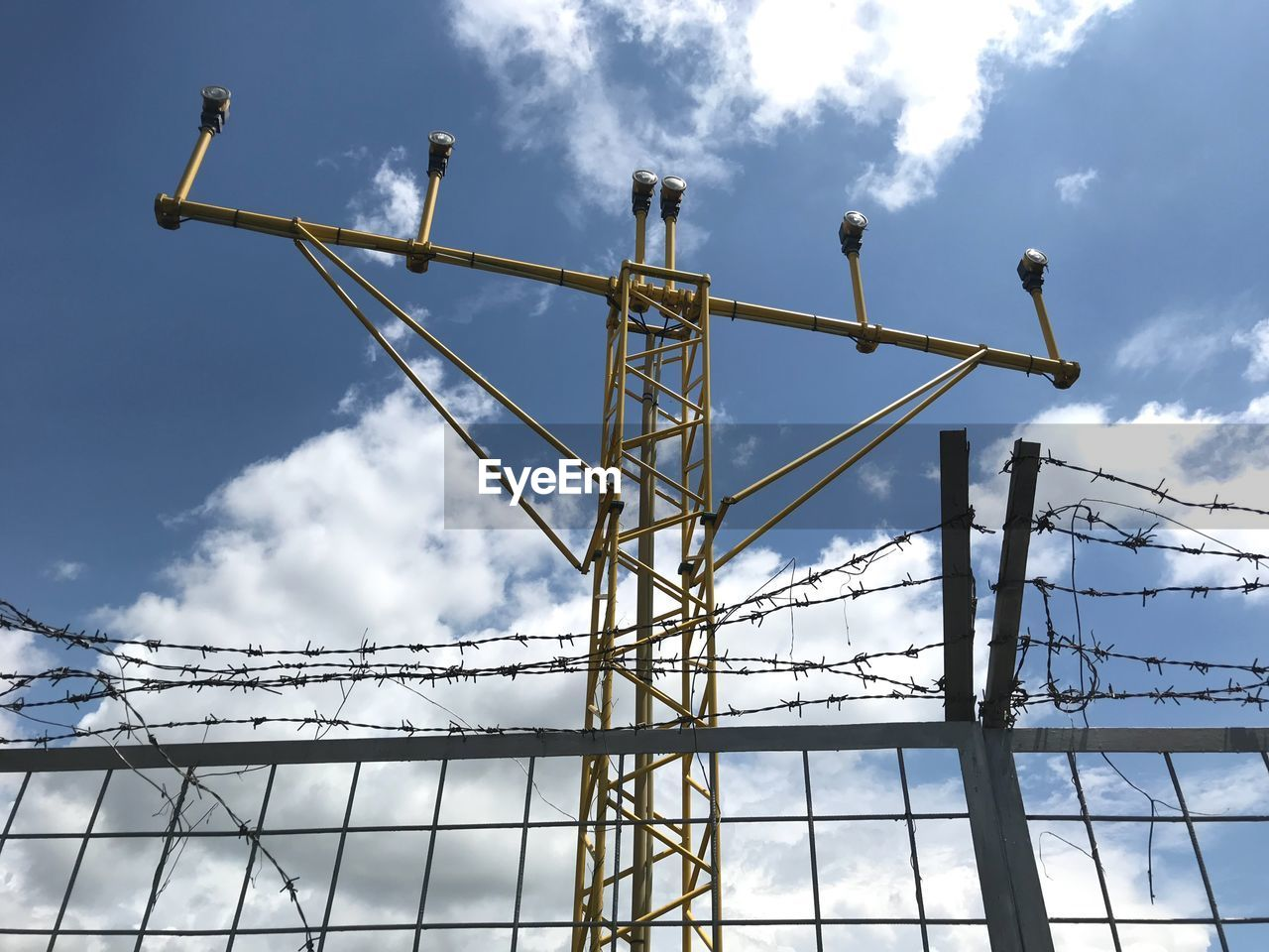 cloud - sky, sky, low angle view, day, nature, no people, built structure, architecture, metal, industry, machinery, incomplete, outdoors, connection, construction industry, crane - construction machinery, development, construction site, cable, power supply