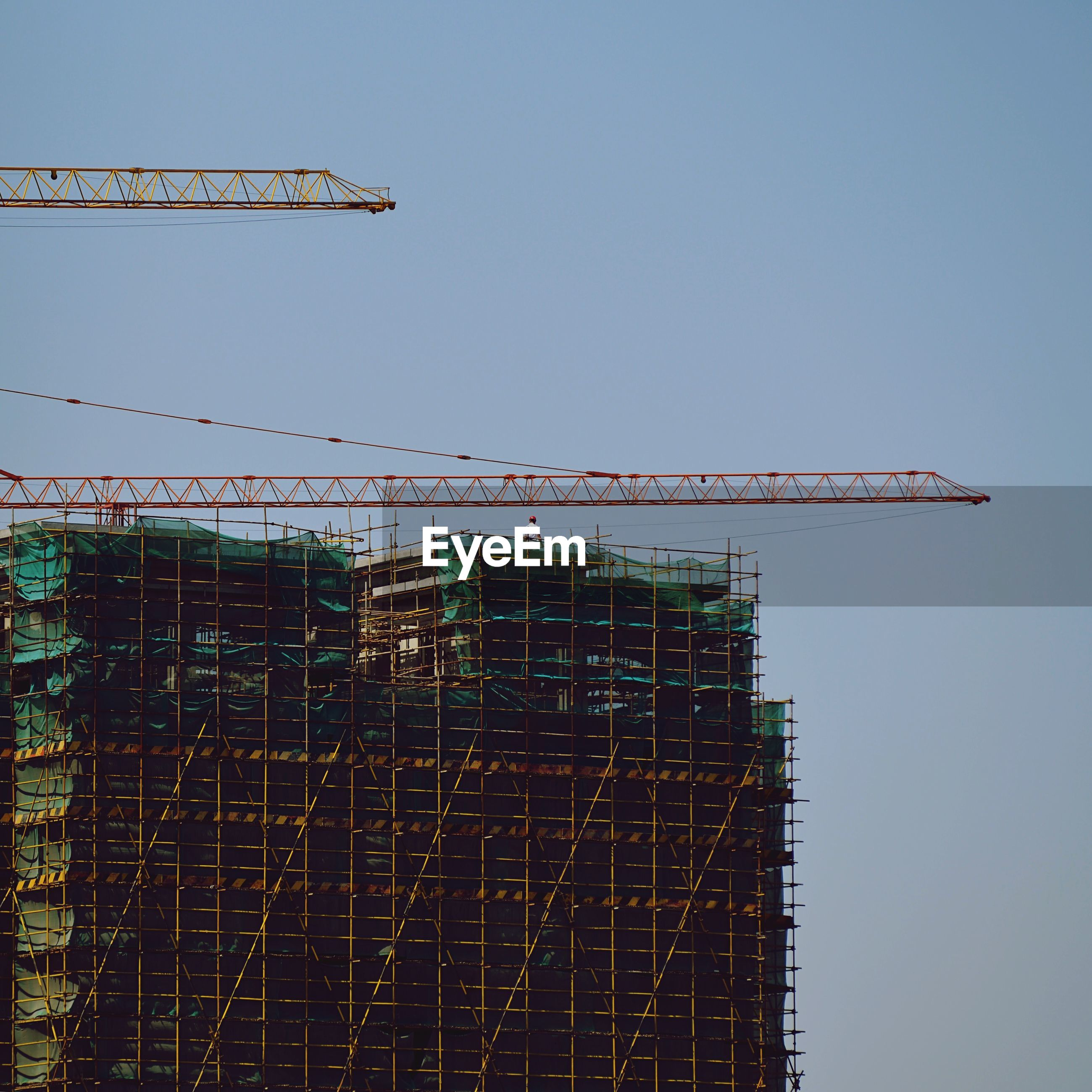 Construction building against clear sky
