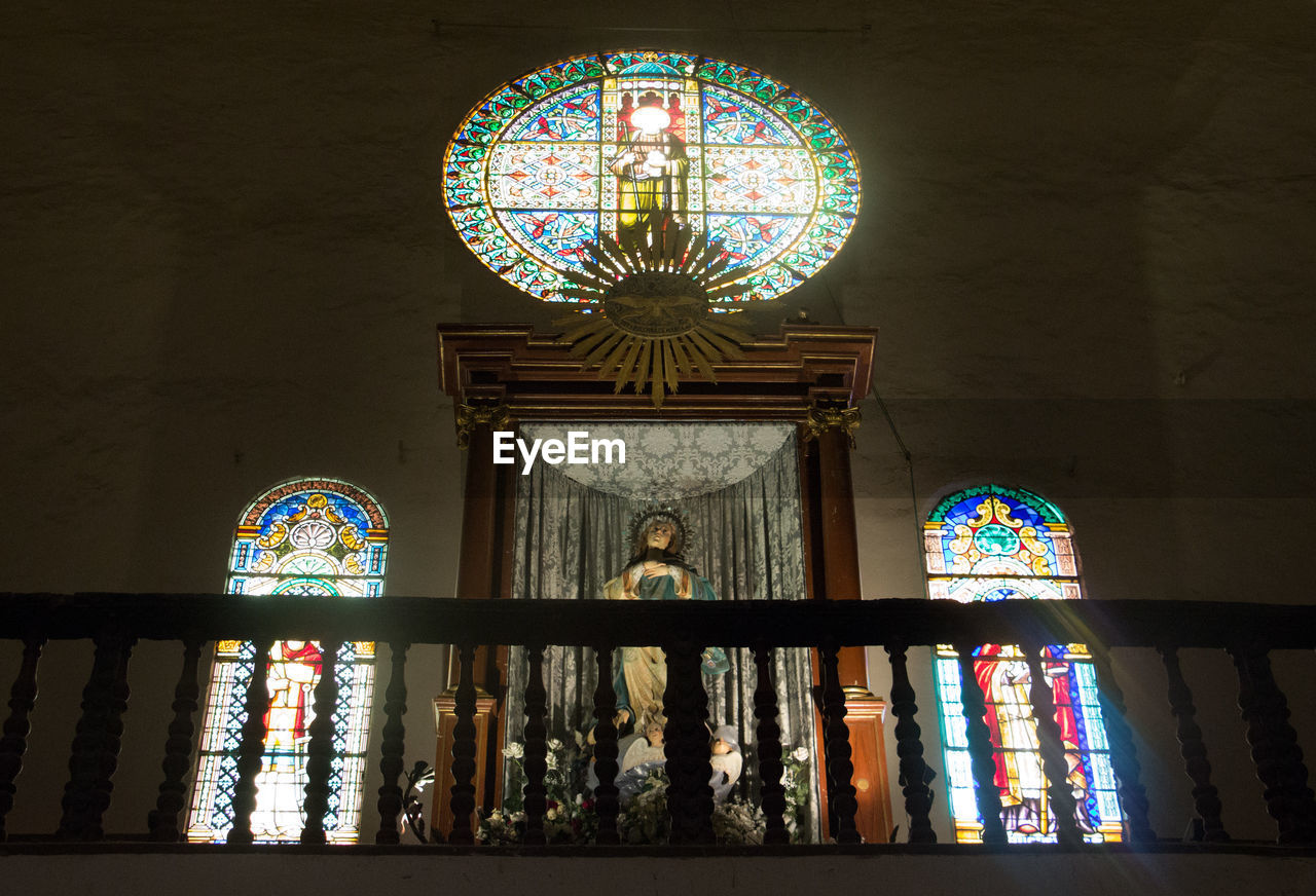 religion, place of worship, architecture, indoors, window, multi colored, low angle view, spirituality, built structure, no people, day