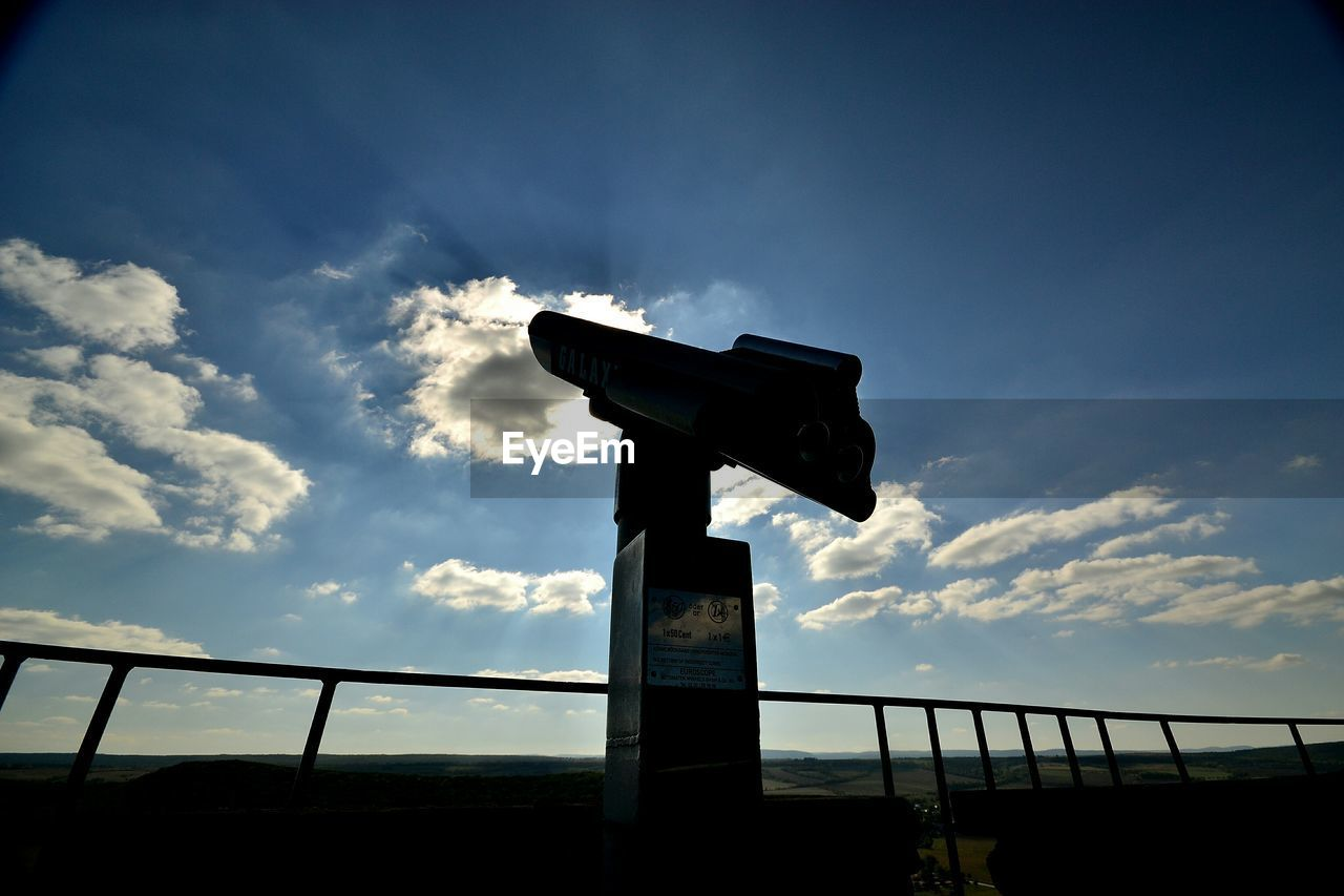 Low angle view of telescope at observation point against sky