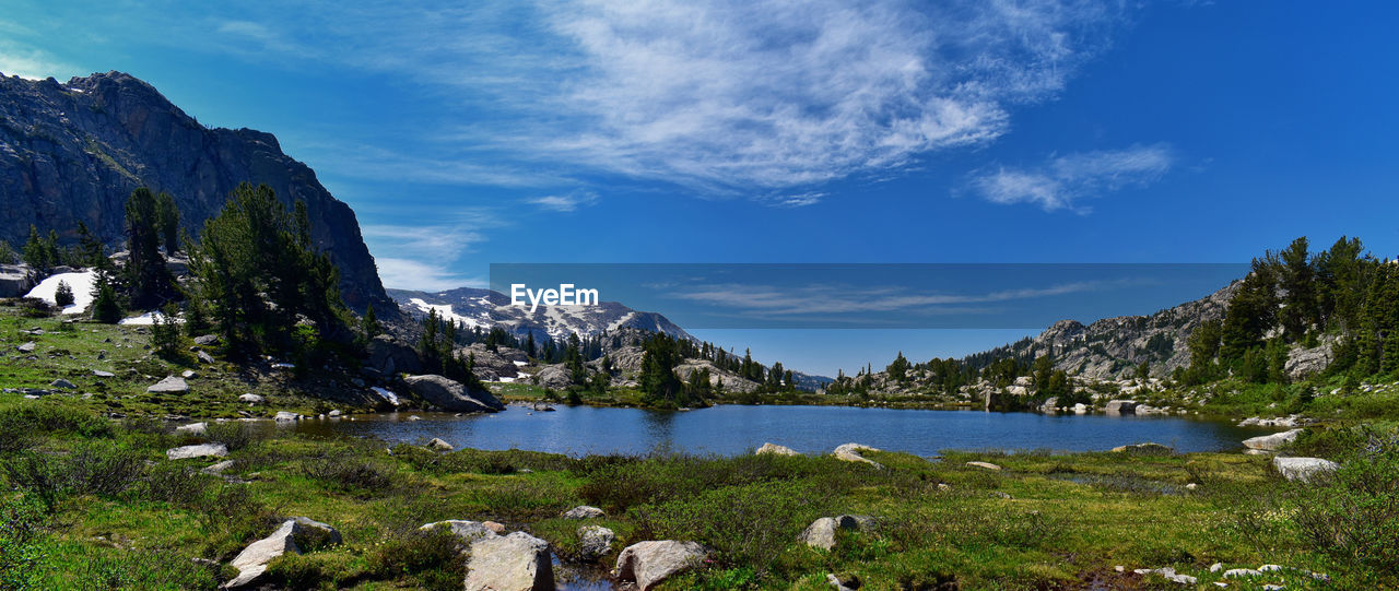 water, sky, scenics - nature, beauty in nature, mountain, cloud - sky, nature, tranquility, lake, day, no people, plant, tranquil scene, mountain range, animal, animal themes, non-urban scene, rock, grass, outdoors