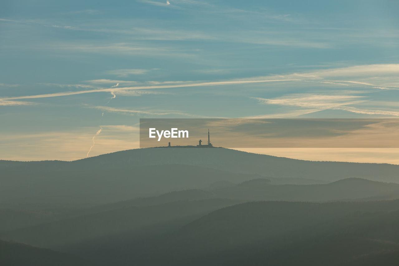 mountain, sky, beauty in nature, scenics - nature, cloud - sky, environment, non-urban scene, mountain range, tranquil scene, tranquility, nature, no people, idyllic, sunset, landscape, outdoors, silhouette, fog, travel, orange color, mountain peak