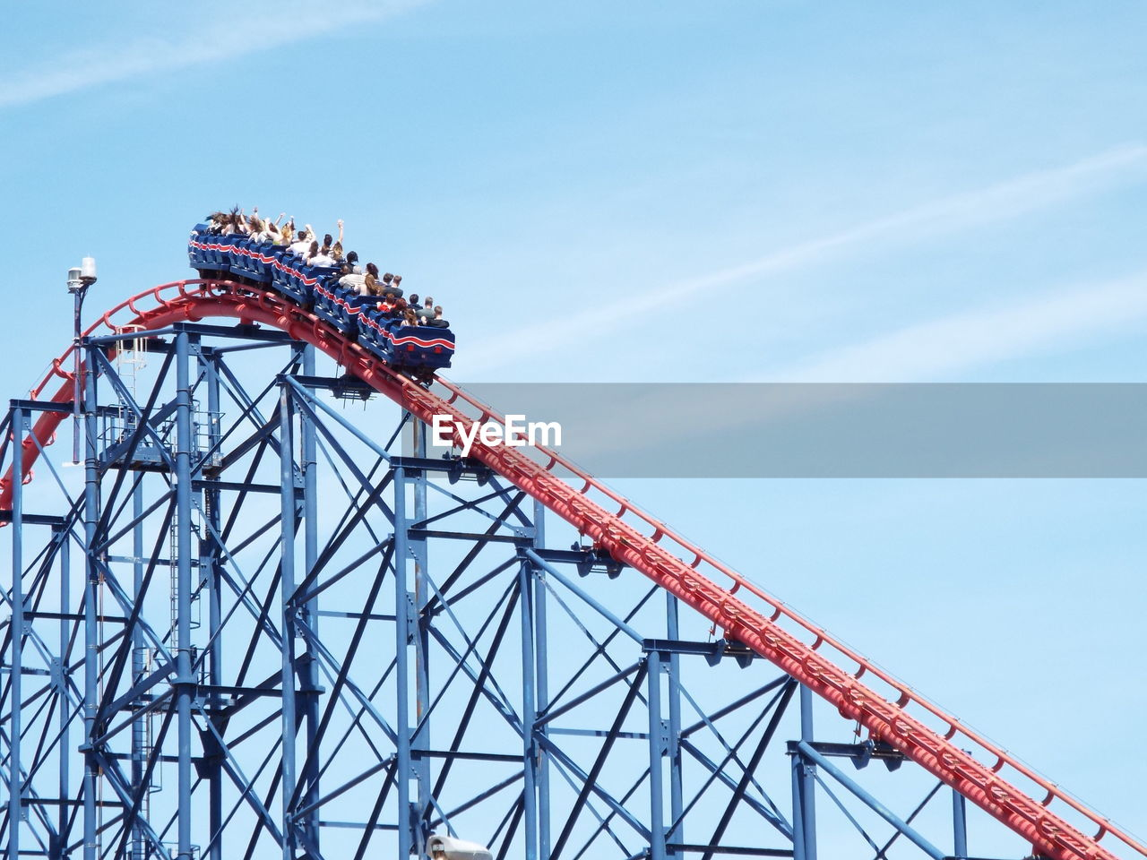 Low Angle View Of People Enjoying Big One Ride At Blackpool Pleasure Beach Against Sky