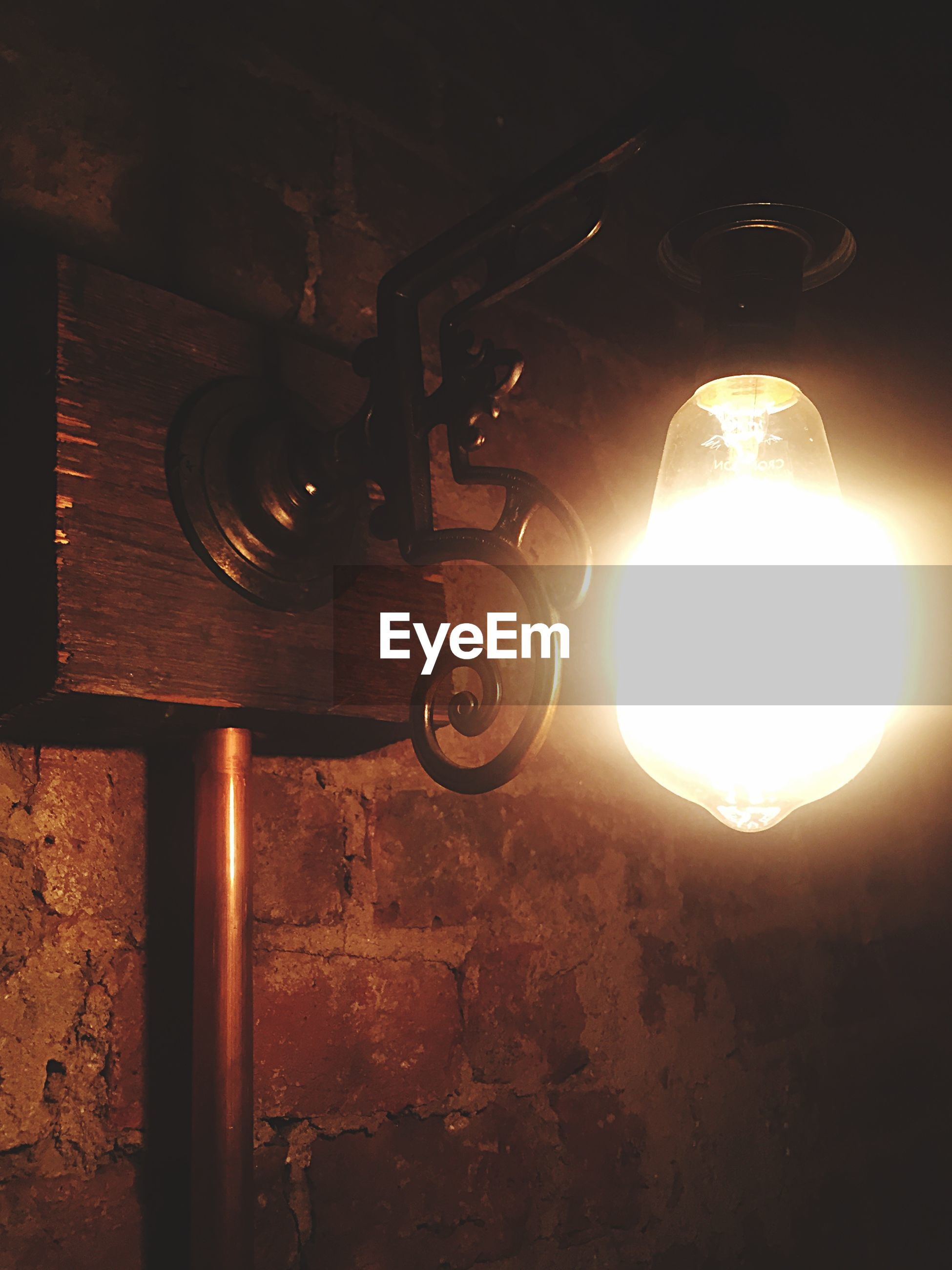 indoors, lighting equipment, old-fashioned, illuminated, wall - building feature, electricity, old, built structure, metal, abandoned, retro styled, architecture, technology, no people, obsolete, low angle view, close-up, sunlight, house, light - natural phenomenon