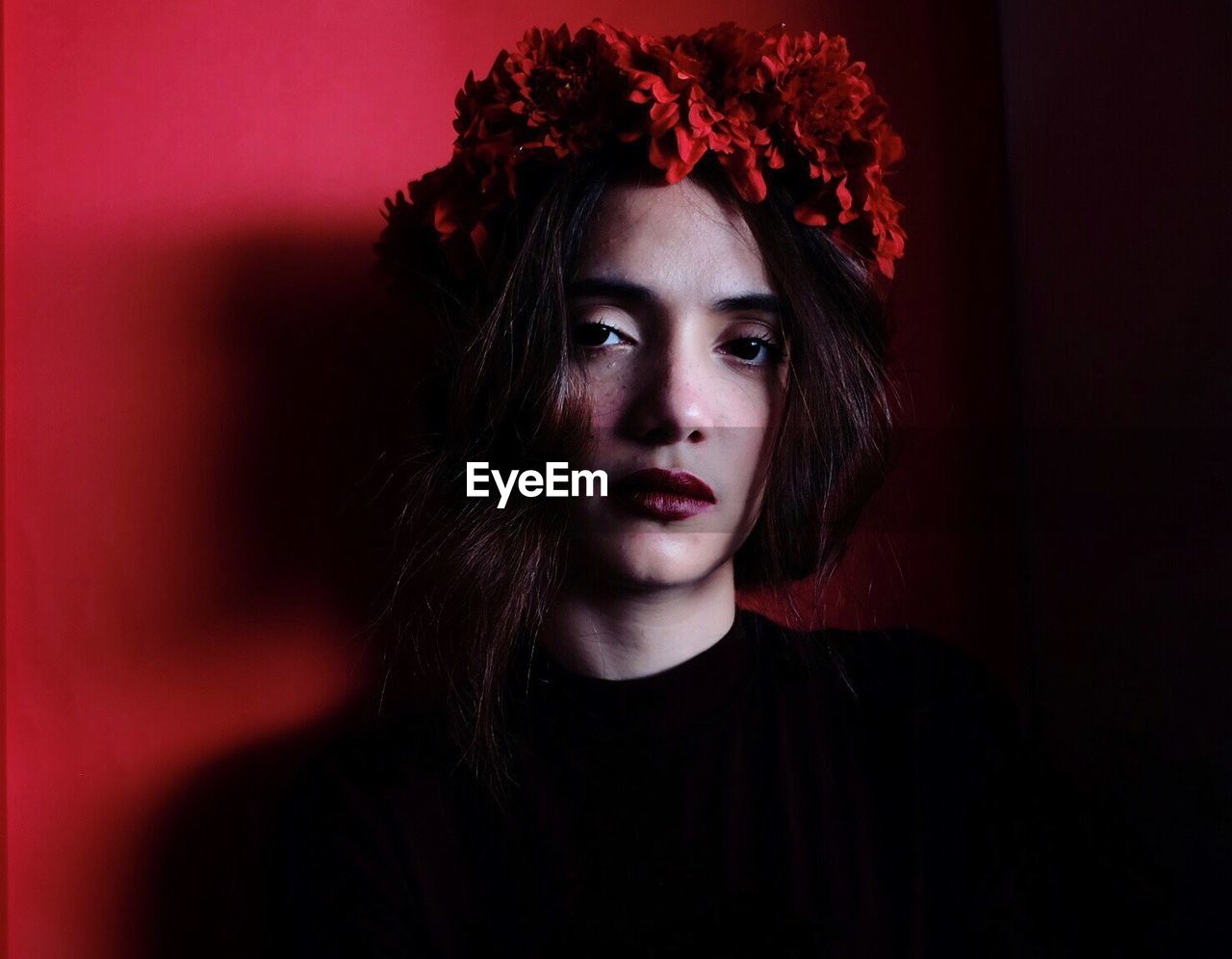 red, portrait, beautiful woman, beauty, looking at camera, young adult, spooky, headshot, one person, flower, one young woman only, make-up, beautiful people, young women, adult, one woman only, halloween, close-up, human body part, night, people, adults only