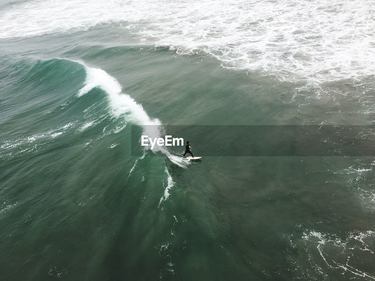 High Angle View Of Boy Surfing On Sea