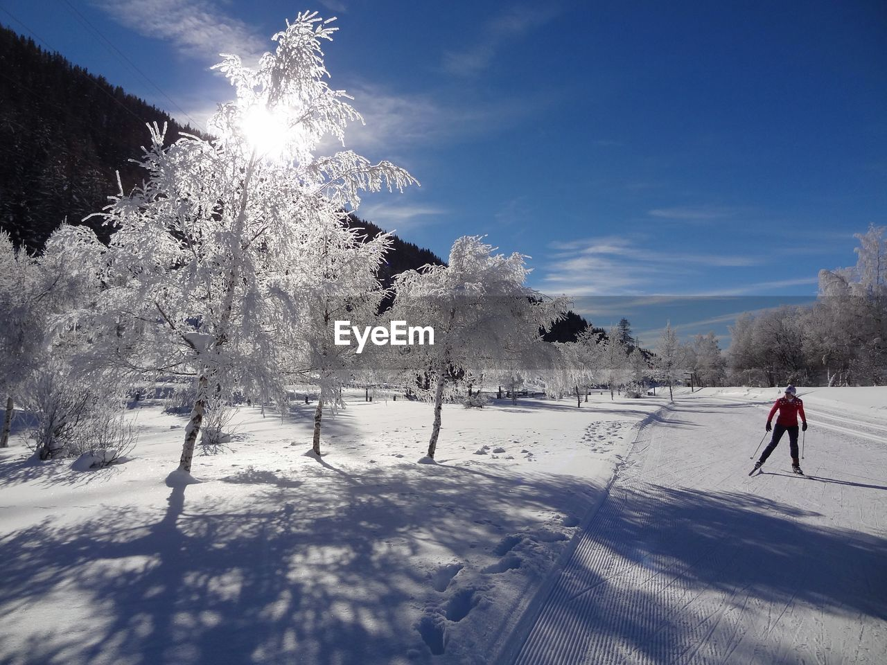 Person skiing on snowcapped landscape during winter