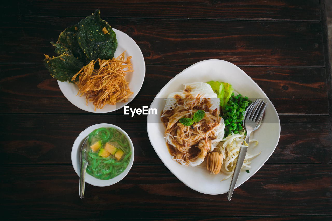 food, food and drink, table, ready-to-eat, freshness, healthy eating, plate, wellbeing, serving size, still life, wood - material, high angle view, meal, vegetable, indoors, no people, directly above, bowl, pasta, fast food, fried, snack, garnish, herb, temptation