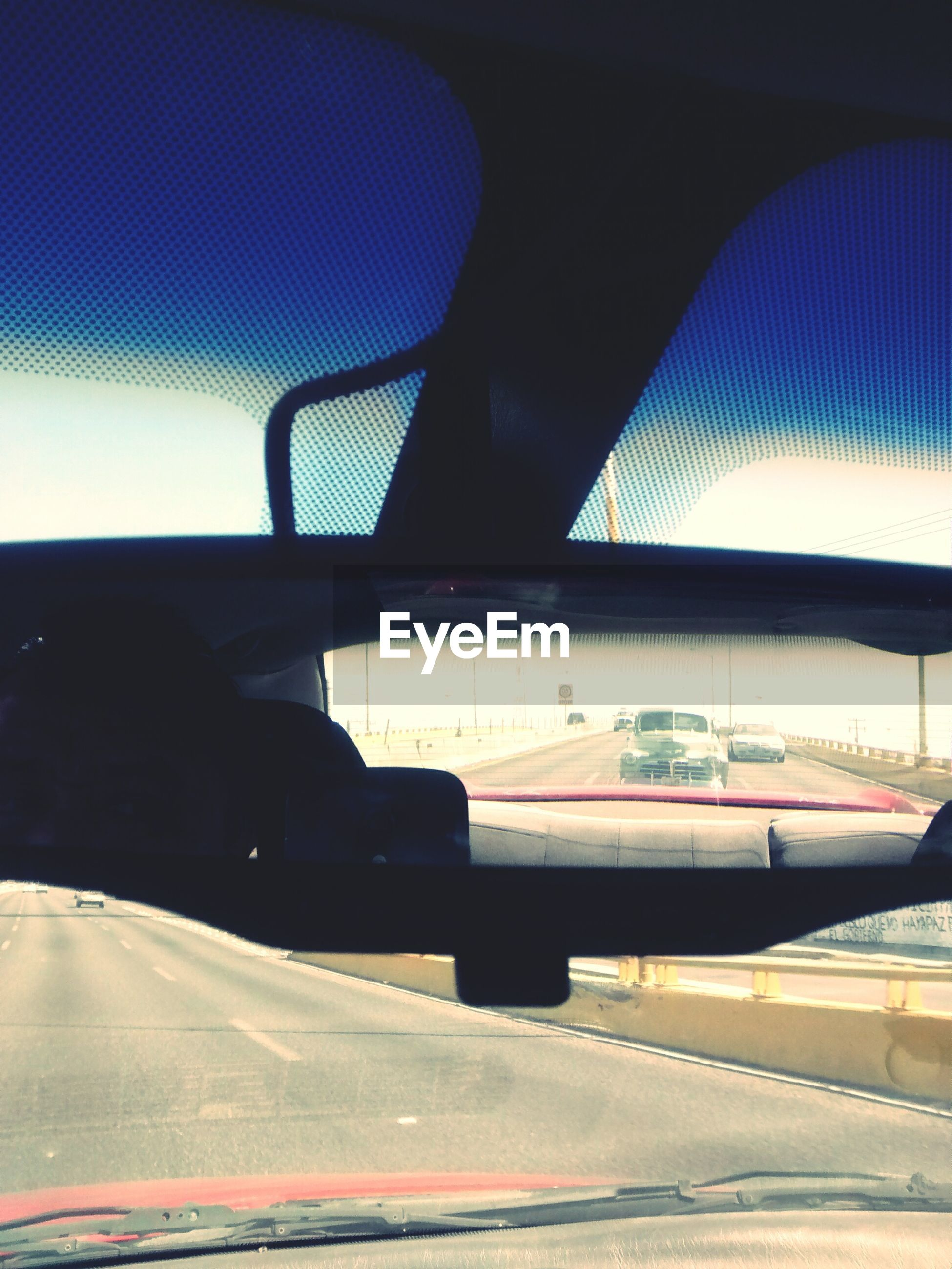 Reflection of cars in rear-view mirror