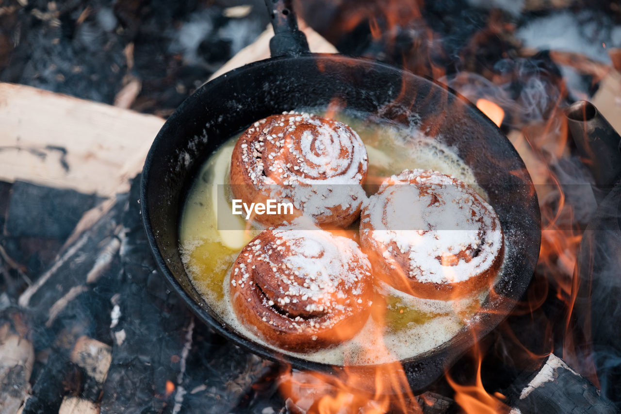 High angle view of cinnamon rolls in a pan on grill