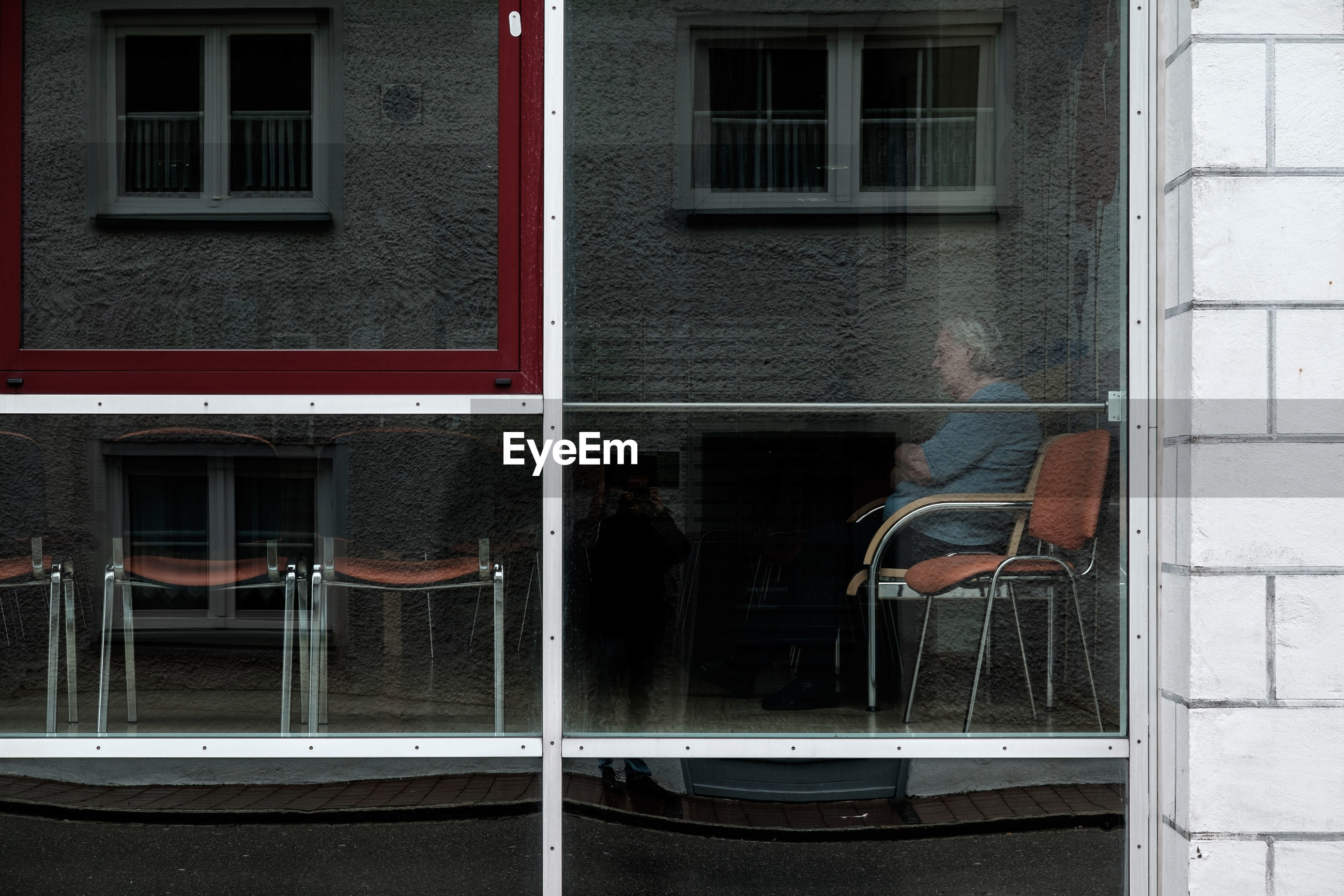 MAN IN FRONT OF WINDOW