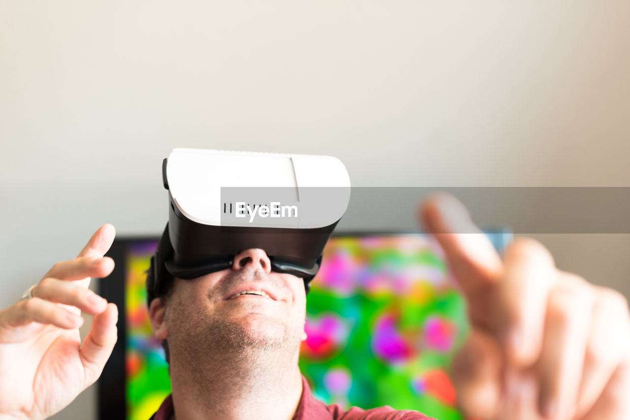 Man looking up through virtual reality glasses