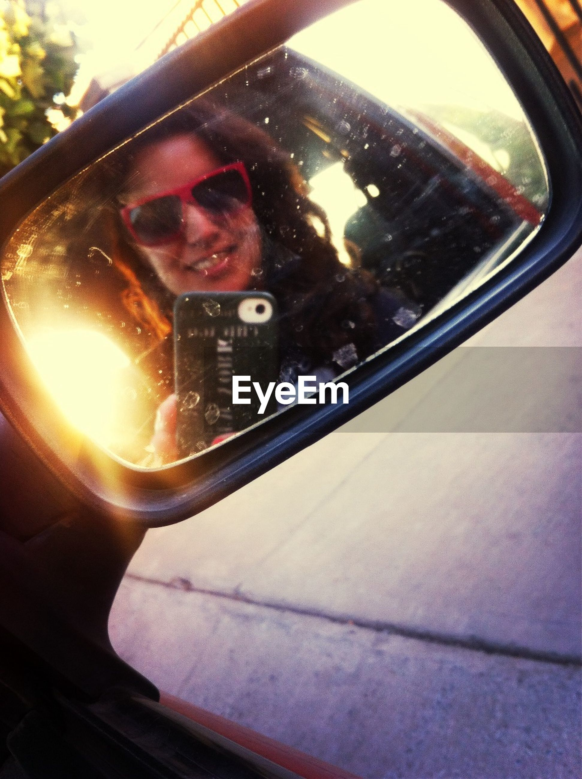 land vehicle, car, mode of transport, indoors, glass - material, vehicle interior, transportation, reflection, transparent, close-up, car interior, side-view mirror, window, photography themes, mirror, technology, part of, sunglasses