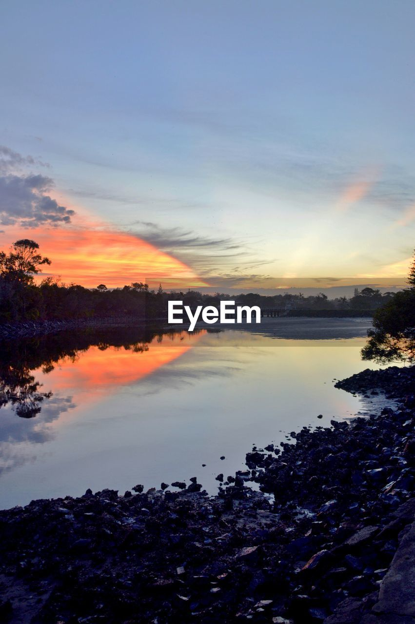 water, sunset, reflection, nature, beauty in nature, sky, tranquil scene, tranquility, scenics, lake, tree, outdoors, no people, cloud - sky, day