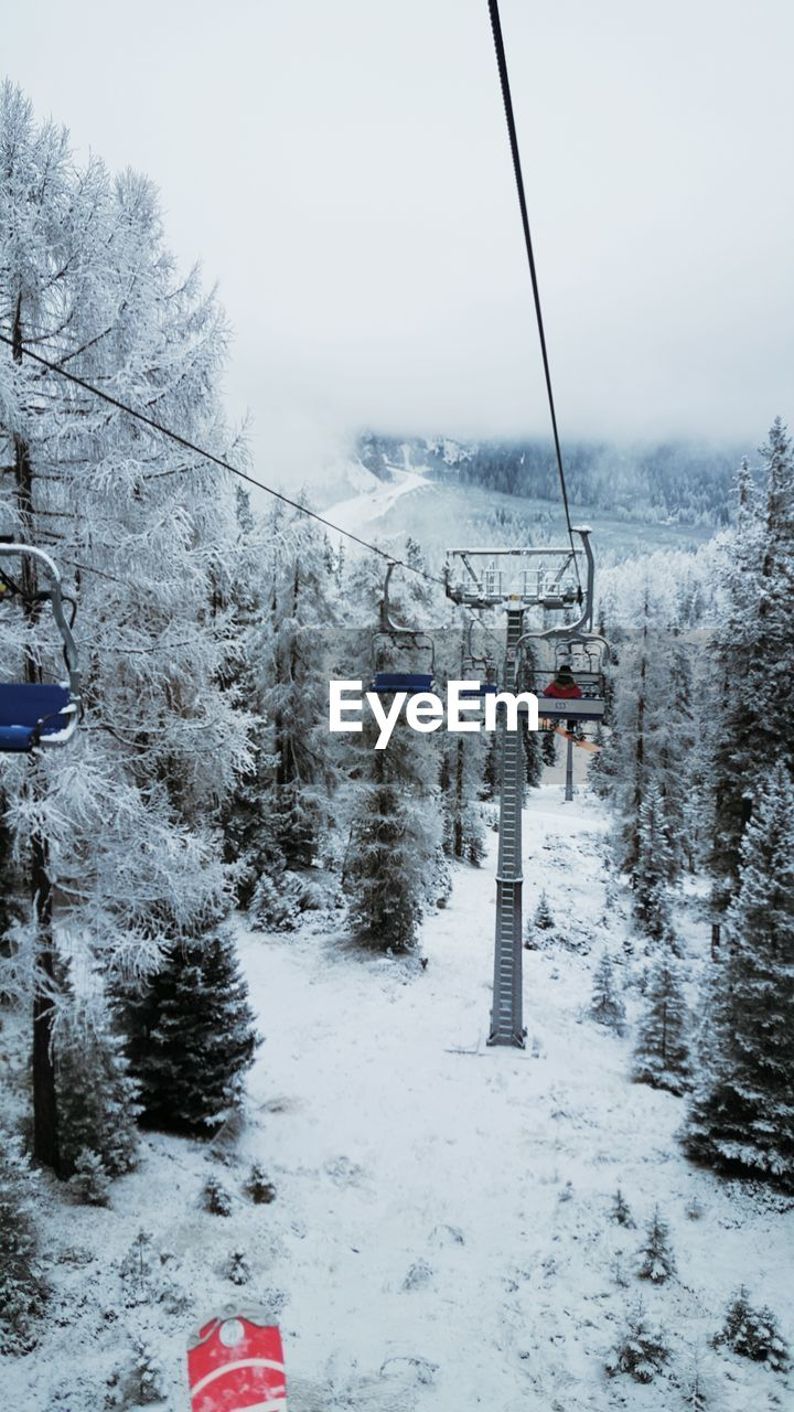 snow, winter, cold temperature, nature, weather, tranquil scene, tranquility, beauty in nature, transportation, day, outdoors, scenics, sky, tree, no people, ski lift, overhead cable car, water