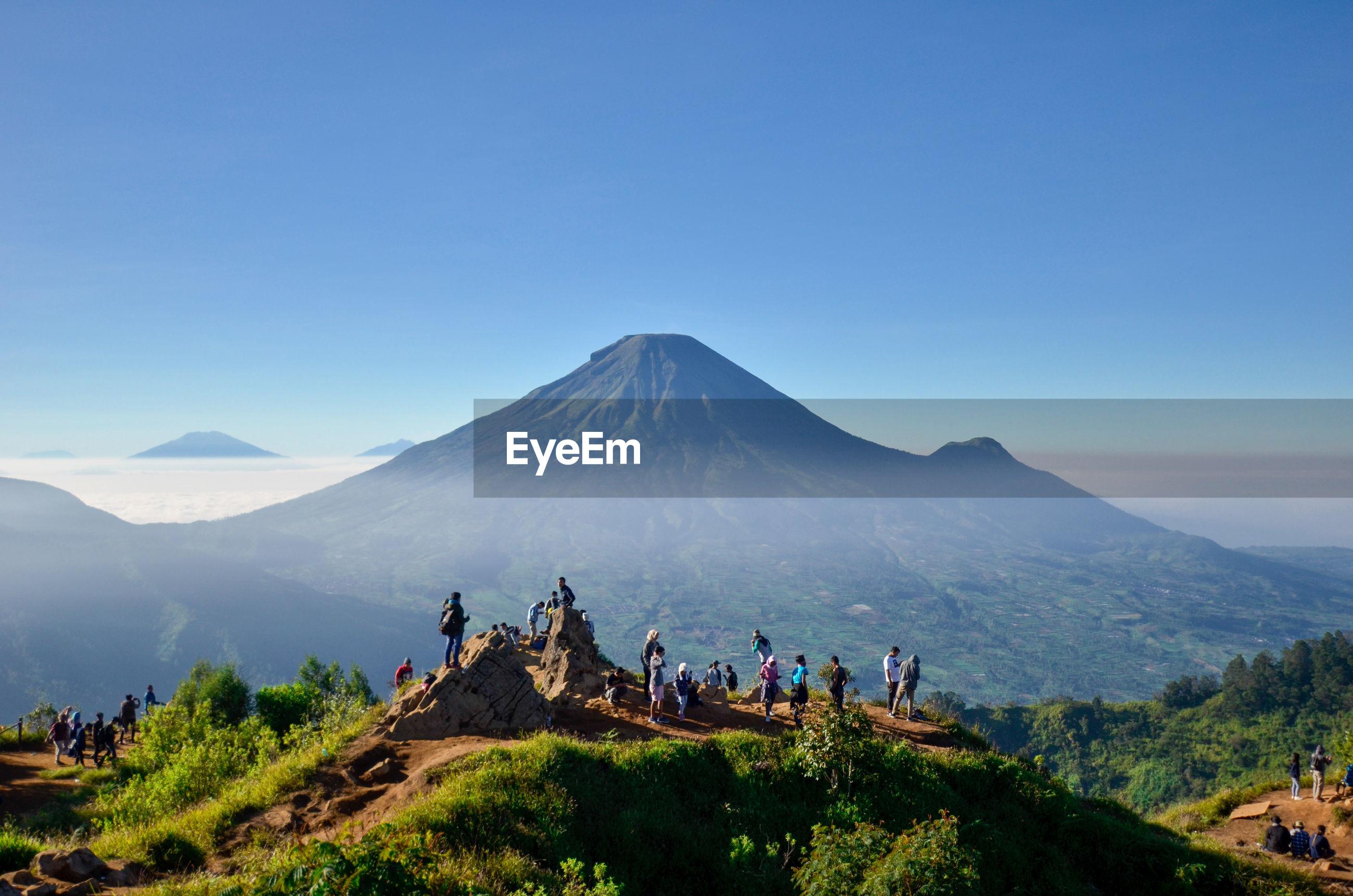 Group of people on mountain range