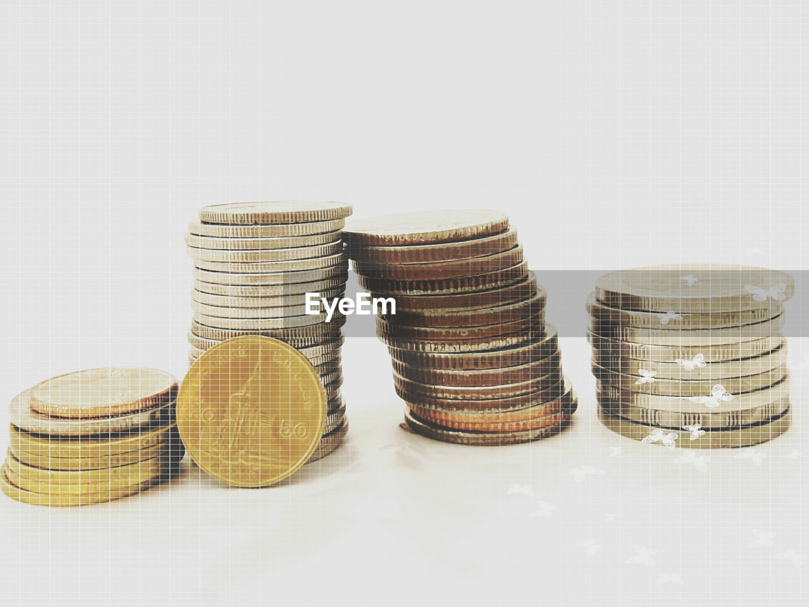 Stacked coins over white background