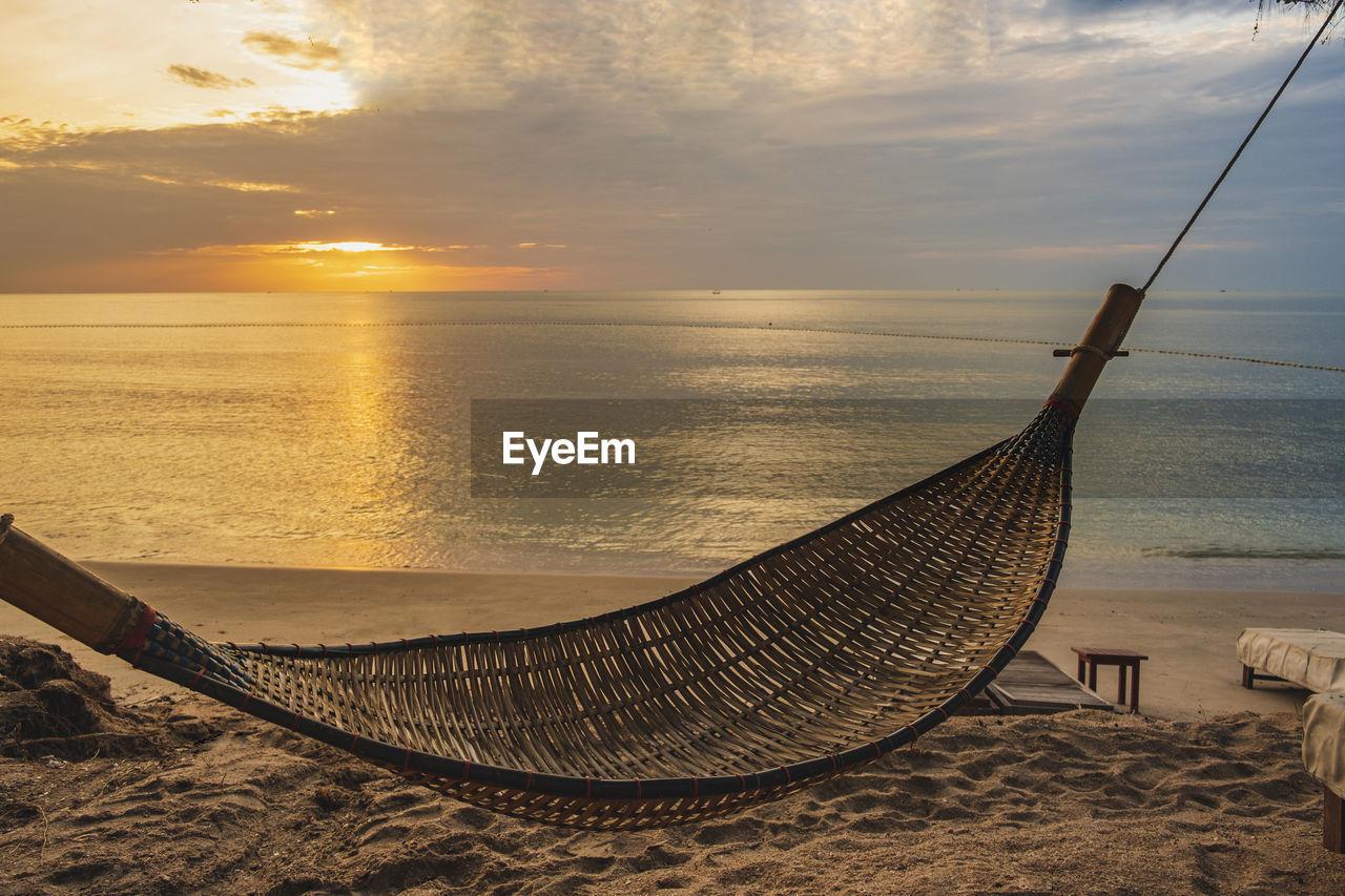 sunset, scenics - nature, water, sky, beauty in nature, beach, land, sea, tranquility, nature, tranquil scene, horizon over water, sand, cloud - sky, horizon, no people, idyllic, sun, non-urban scene, outdoors