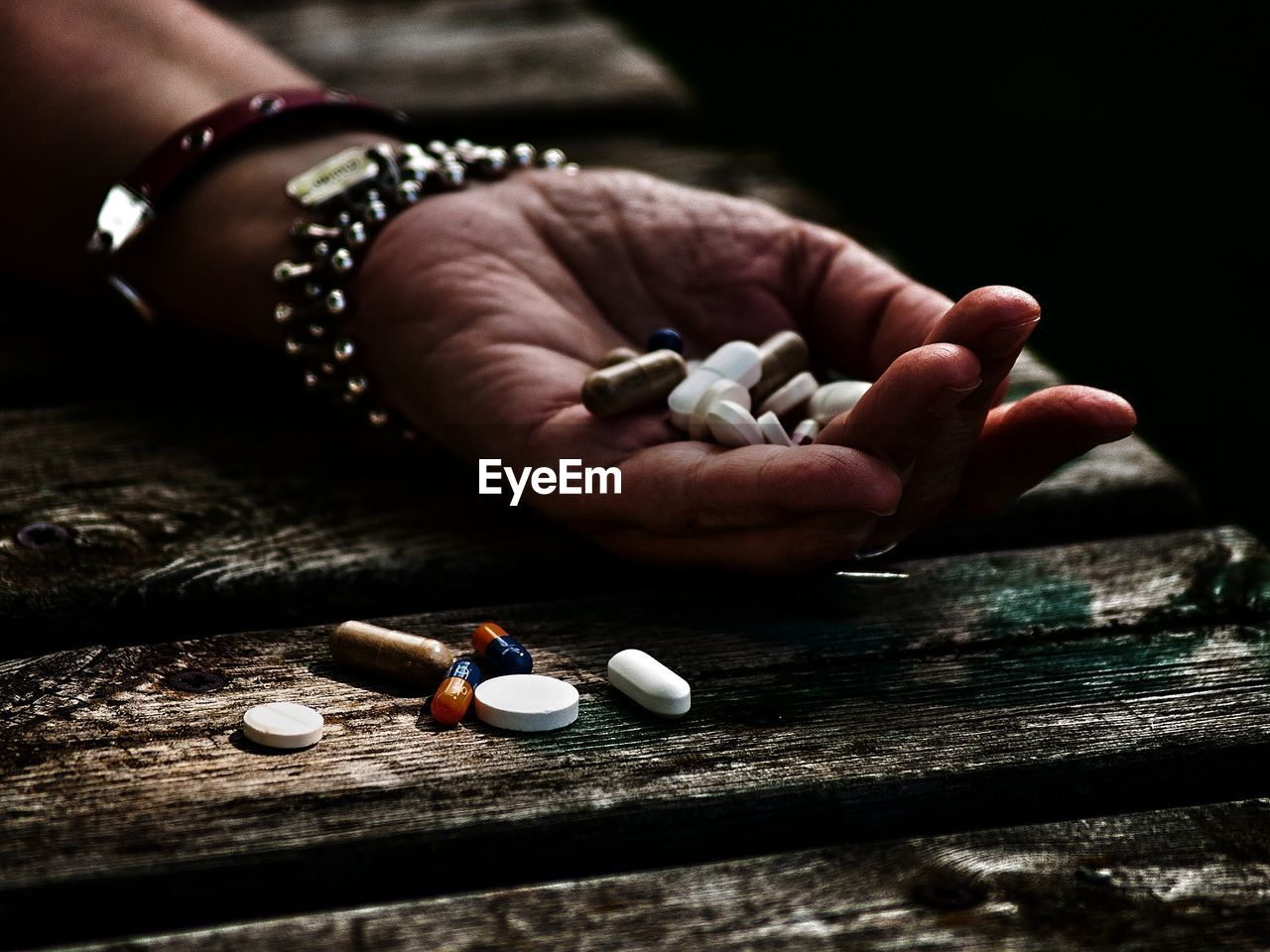 medicine, healthcare and medicine, pill, dose, human hand, human body part, hand, one person, close-up, capsule, body part, indoors, table, narcotic, prescription medicine, real people, wood - material, nutritional supplement, finger