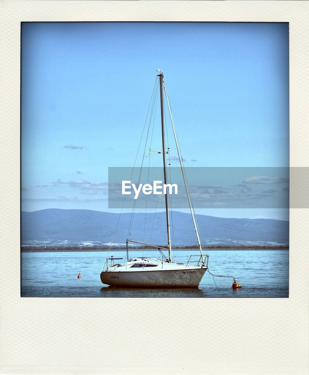 nautical vessel, transportation, mode of transport, no people, water, boat, sea, blue, moored, day, sailboat, outdoors, scenics, sky, mast, tranquility, nature, horizon over water, harbor, beauty in nature