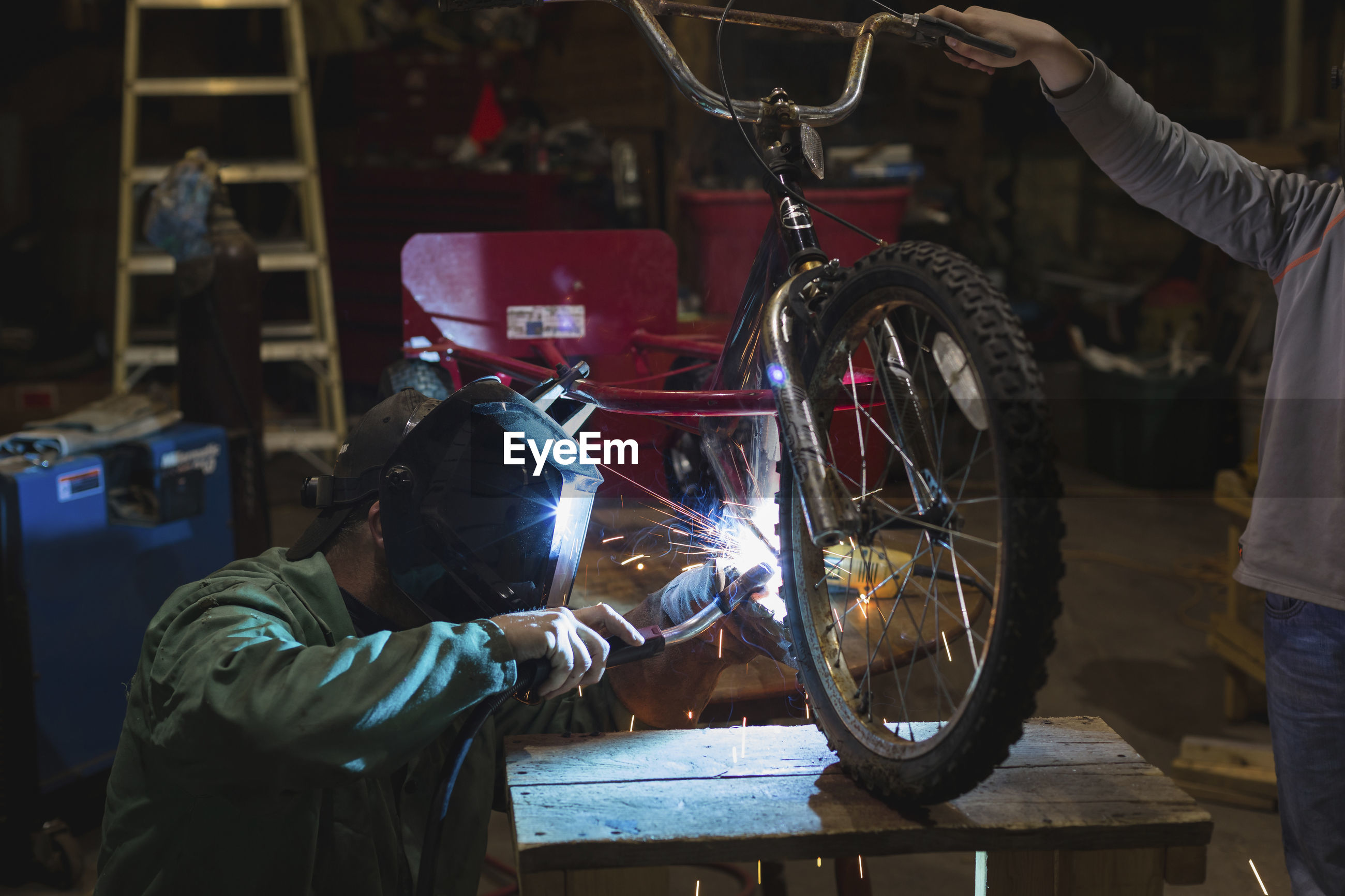 MAN WORKING IN BICYCLE