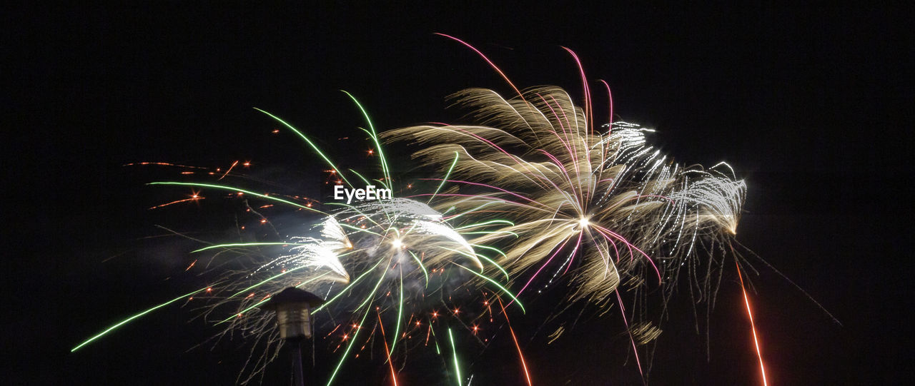 night, illuminated, firework, motion, celebration, event, long exposure, arts culture and entertainment, firework display, glowing, exploding, multi colored, low angle view, sky, blurred motion, firework - man made object, light, no people, nature, sparks