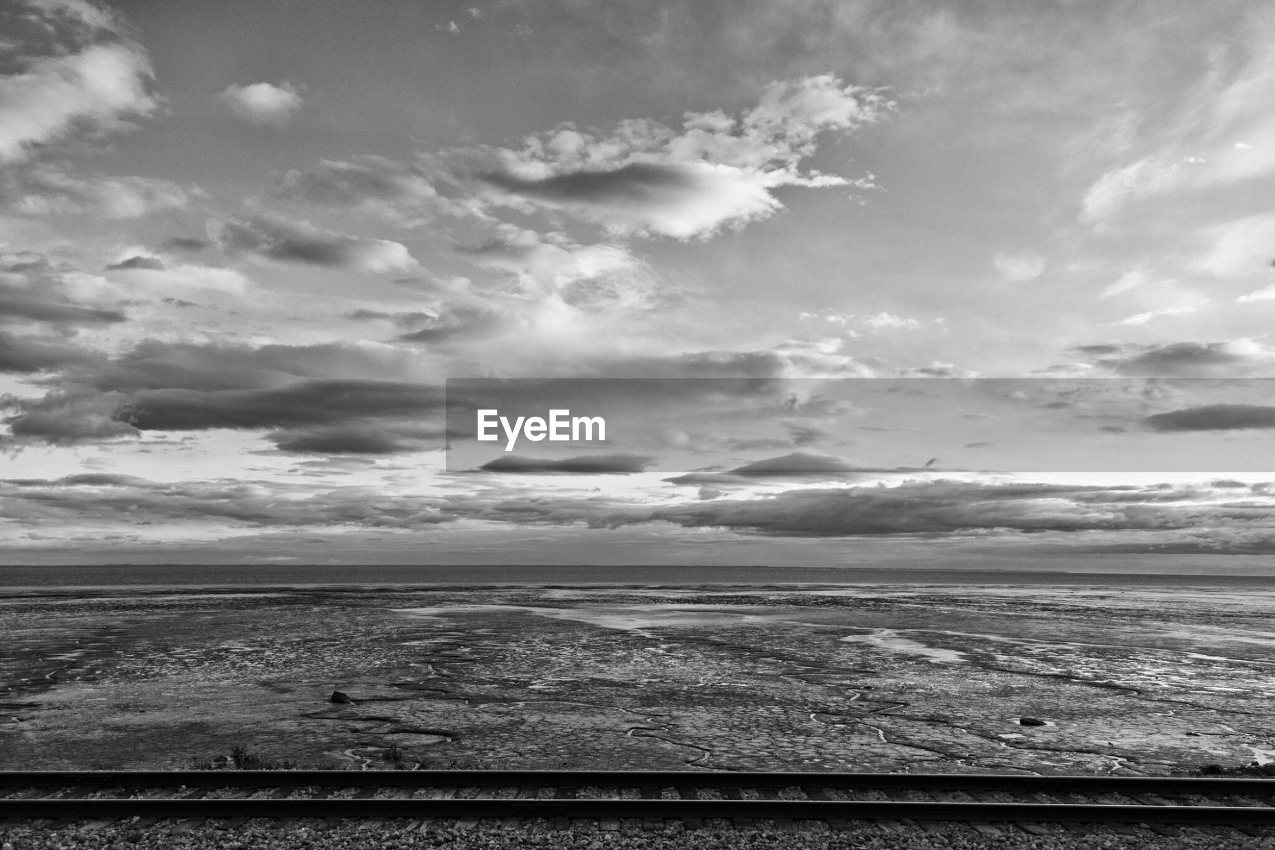 sea, horizon over water, water, sky, tranquil scene, beach, scenics, tranquility, beauty in nature, cloud - sky, shore, nature, cloud, cloudy, idyllic, seascape, sand, wave, coastline, calm
