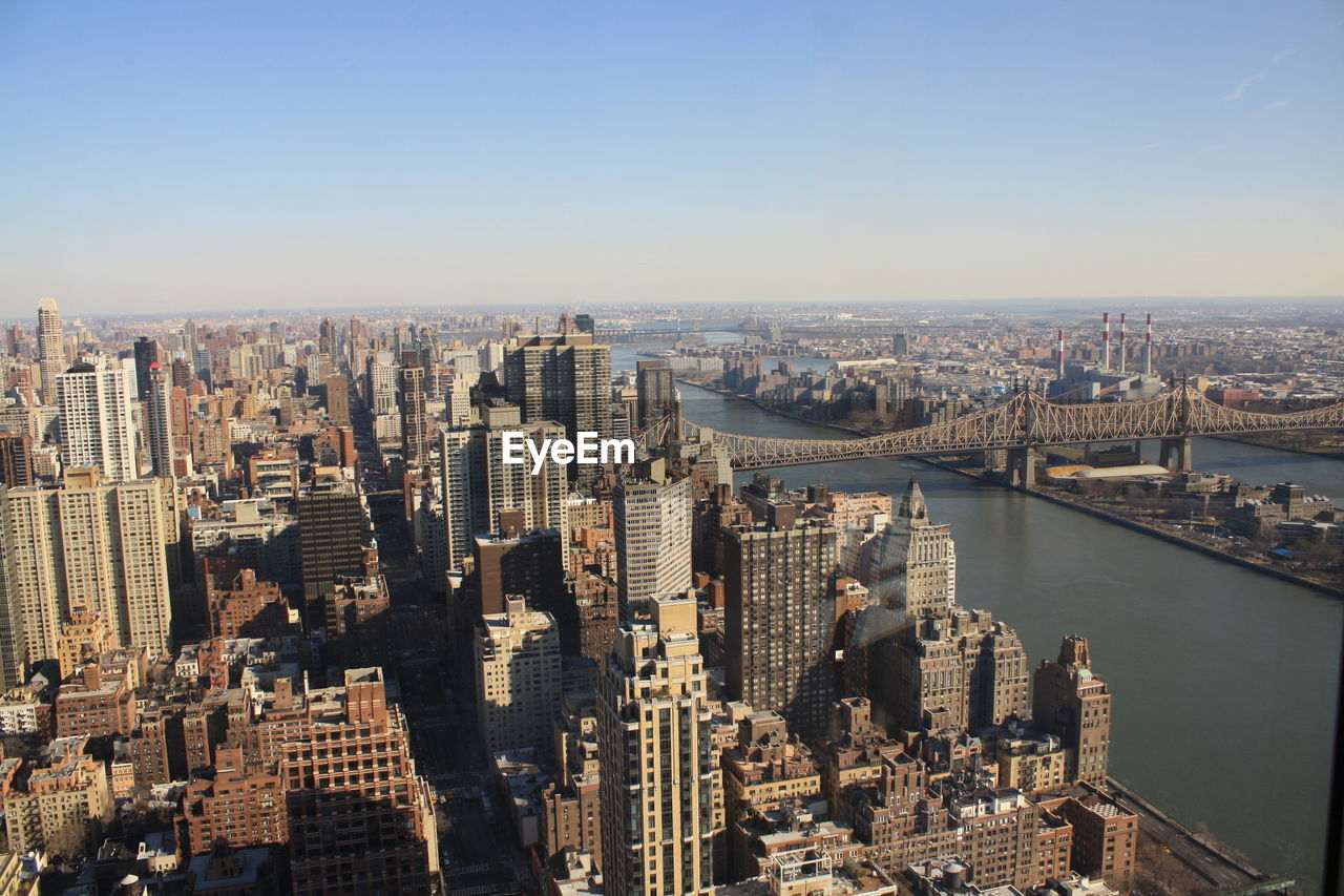 architecture, cityscape, city, built structure, building exterior, skyscraper, connection, crowded, river, aerial view, travel destinations, modern, outdoors, water, day, sky