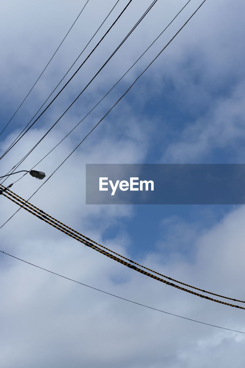cable, low angle view, sky, connection, cloud - sky, power line, no people, power supply, electricity, day, outdoors, nature