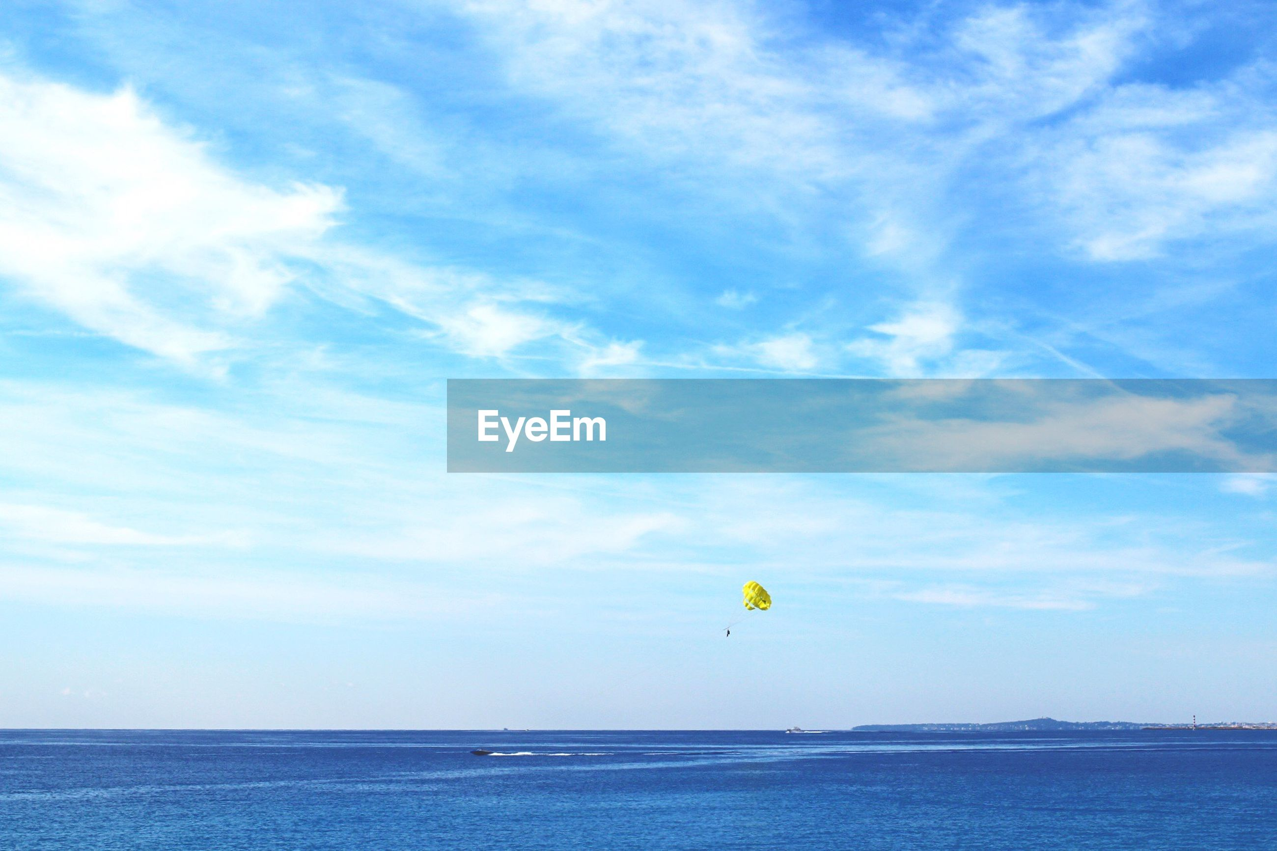 sea, horizon over water, water, sky, blue, waterfront, tranquility, scenics, tranquil scene, beach, cloud - sky, beauty in nature, transportation, nature, parachute, flying, cloud, mid-air, day, idyllic