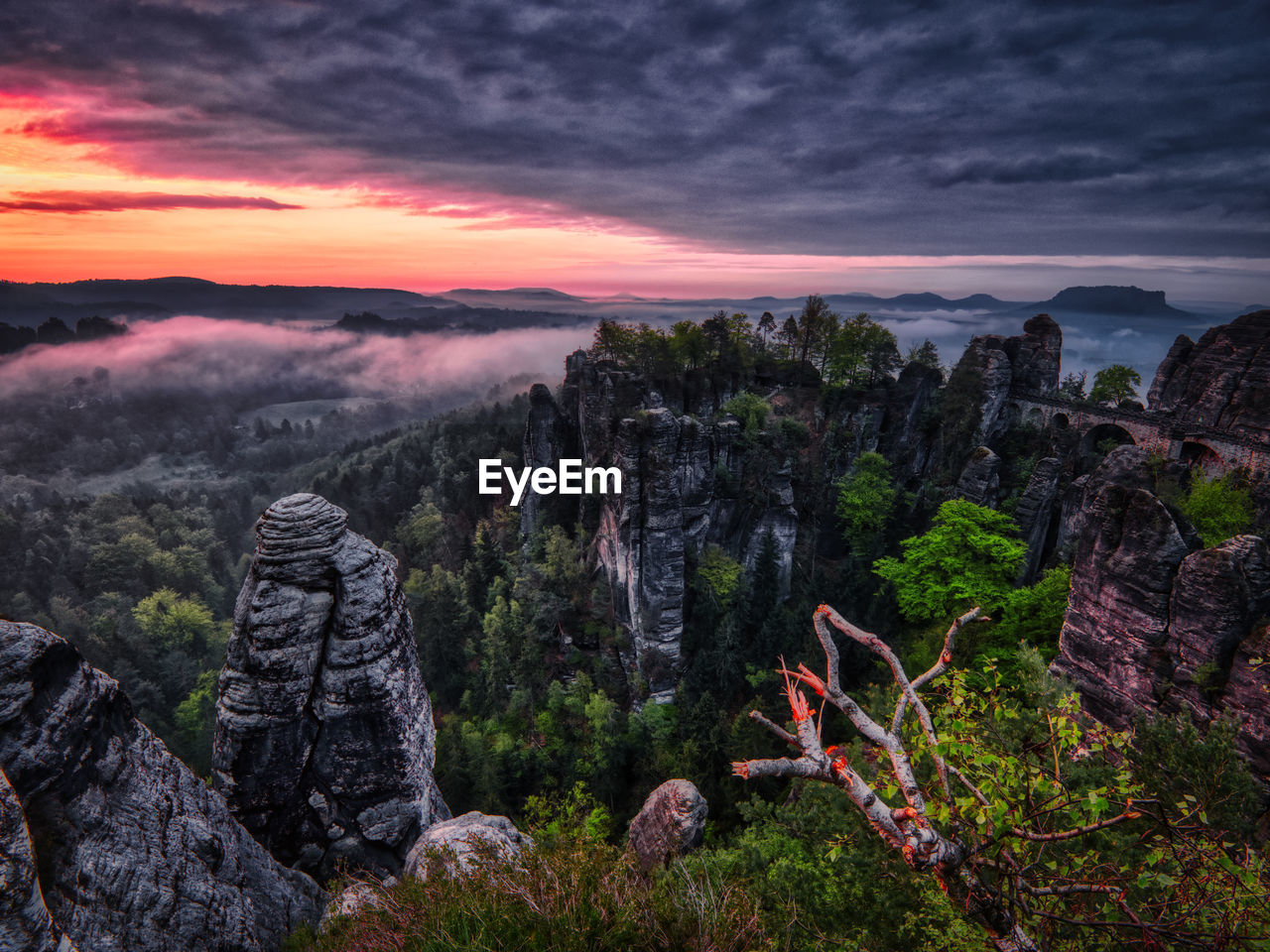sky, cloud - sky, scenics - nature, beauty in nature, tranquil scene, mountain, sunset, tranquility, nature, environment, no people, rock, land, landscape, non-urban scene, solid, idyllic, rock - object, tree, outdoors, mountain peak