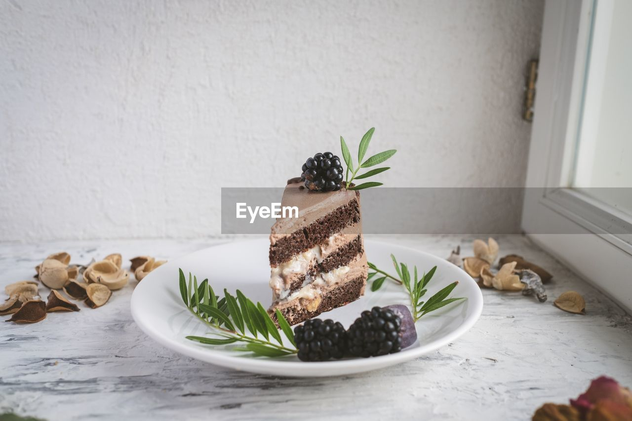 food, freshness, indoors, food and drink, no people, still life, leaf, sweet food, plant part, table, dessert, ready-to-eat, close-up, sweet, plant, indulgence, plate, baked, potted plant, serving size, herb, temptation